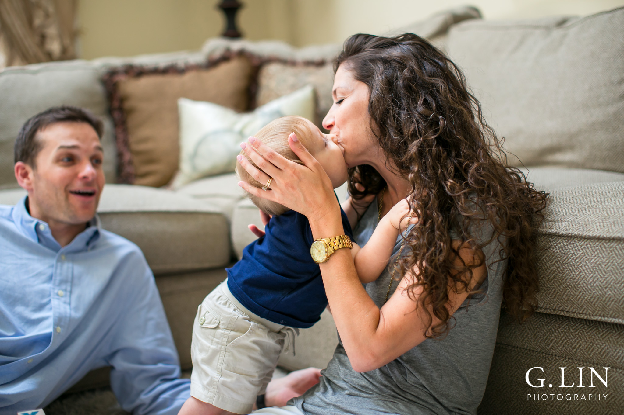 Raleigh Family Photographer | G. Lin Photography | Baby kissing mommy on the cheek in the living room