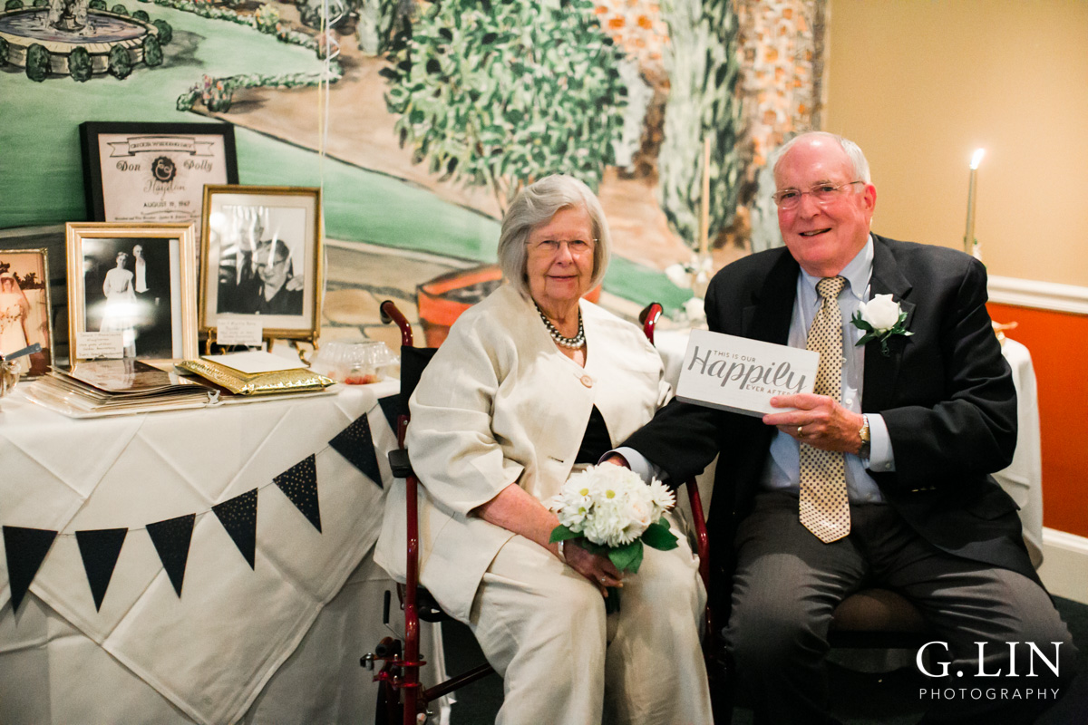 Raleigh Family Photographer | G. Lin Photography | Couple smiling at camera and holding wedding sign