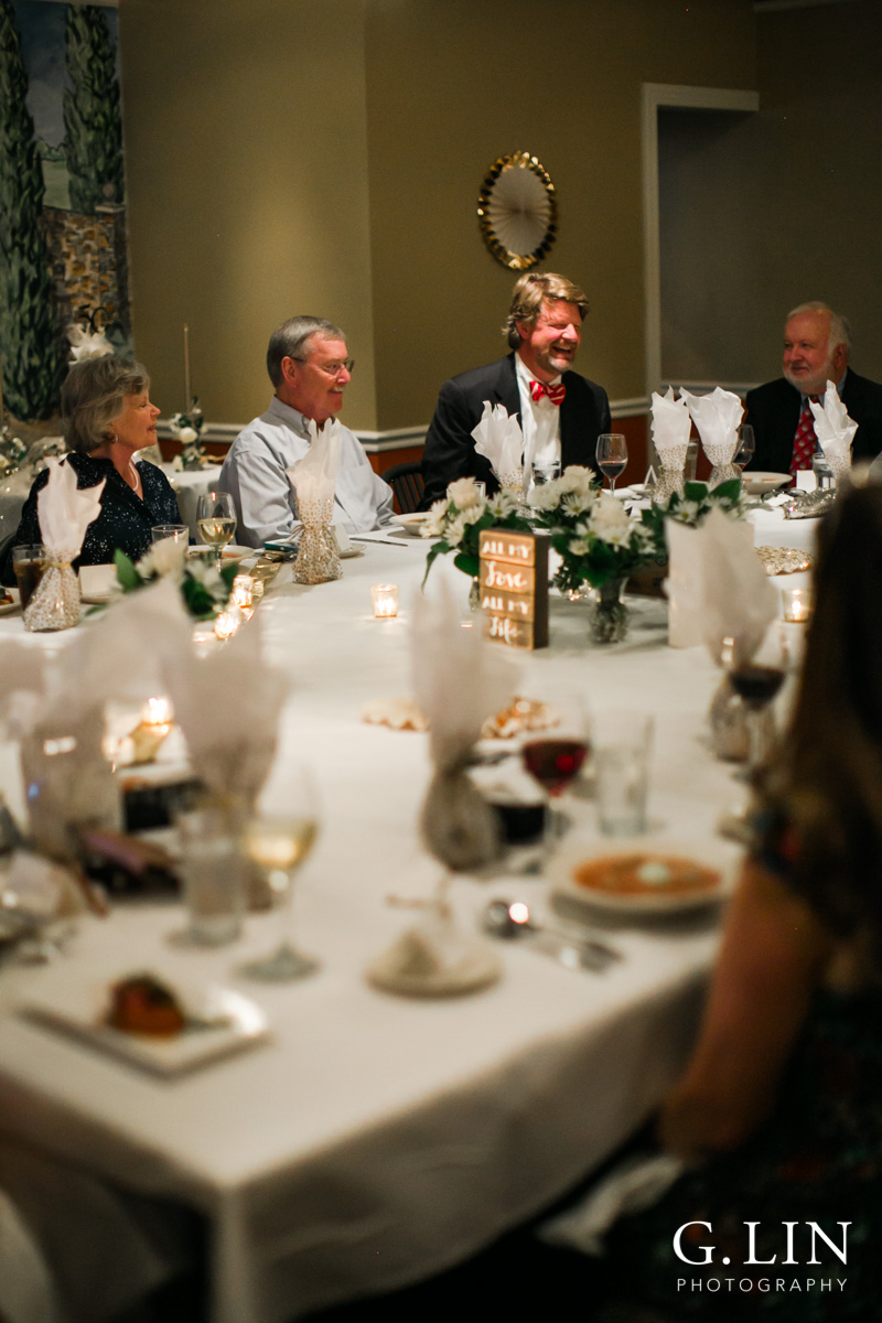 Raleigh Event Photographer | G. Lin Photography | Guests laughing around a table
