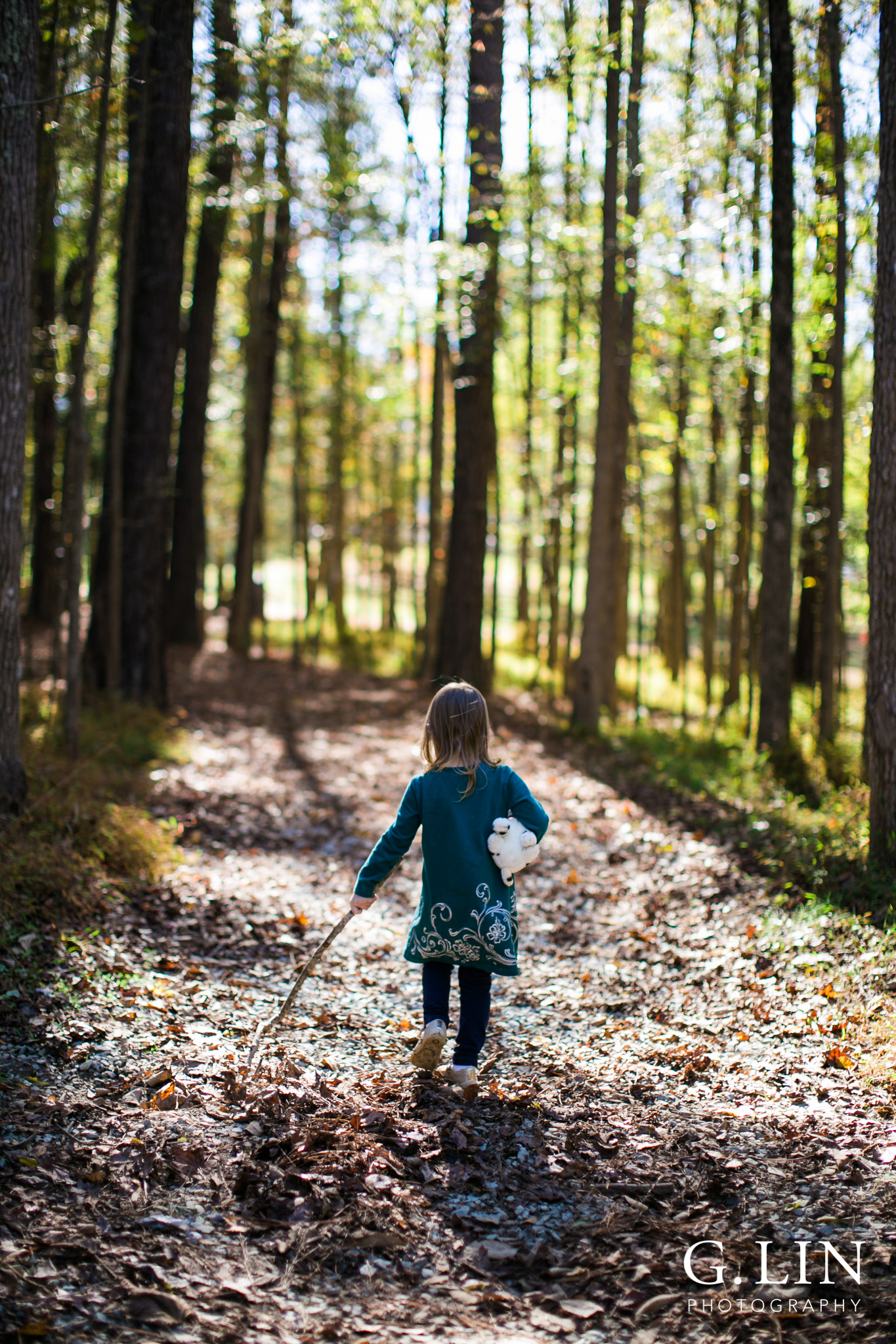 Durham Family Photographer | G. Lin Photography | Little girl walking in woods