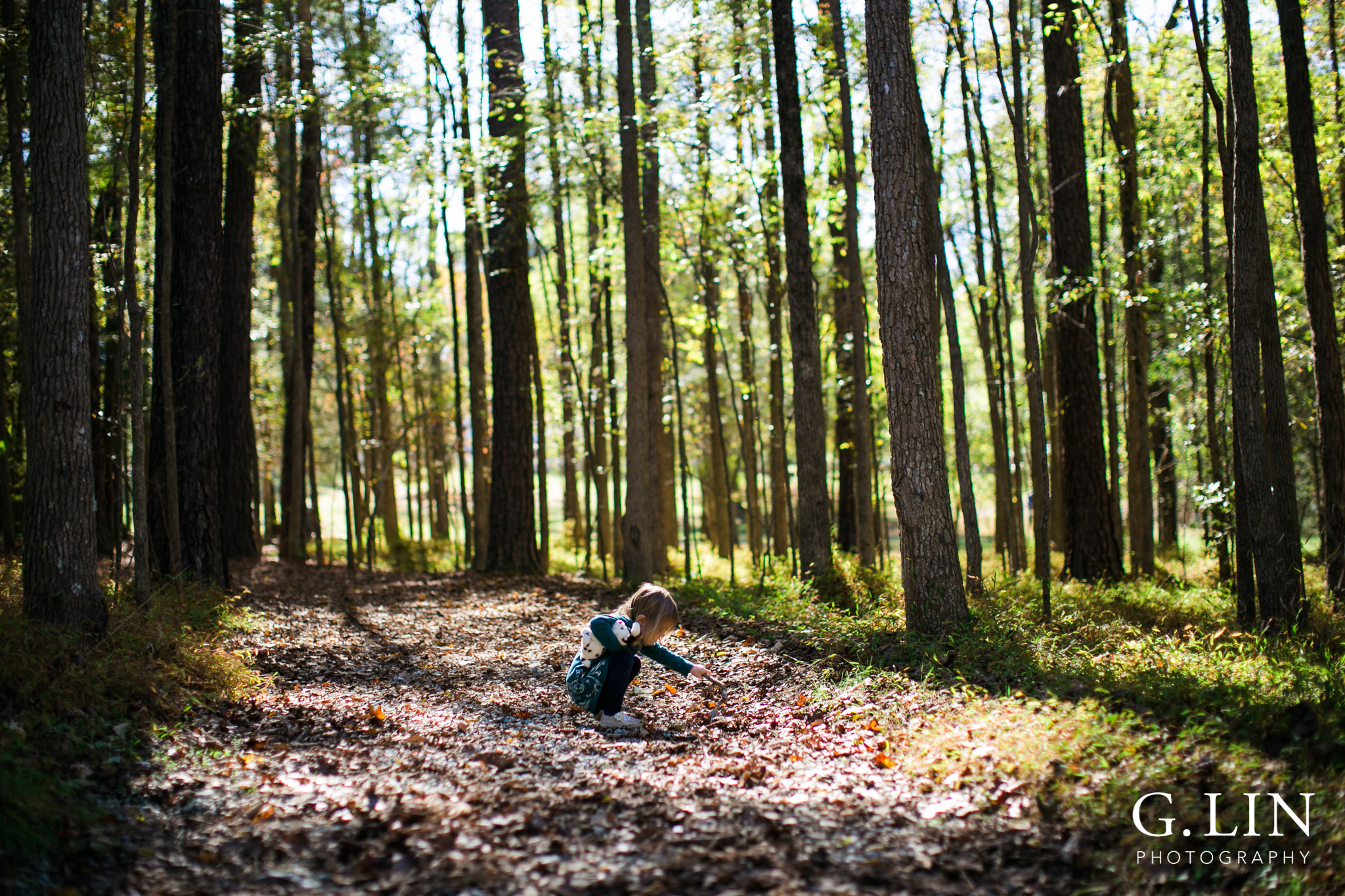 Durham Family Photographer | G. Lin Photography | Little girl exploring in the forest