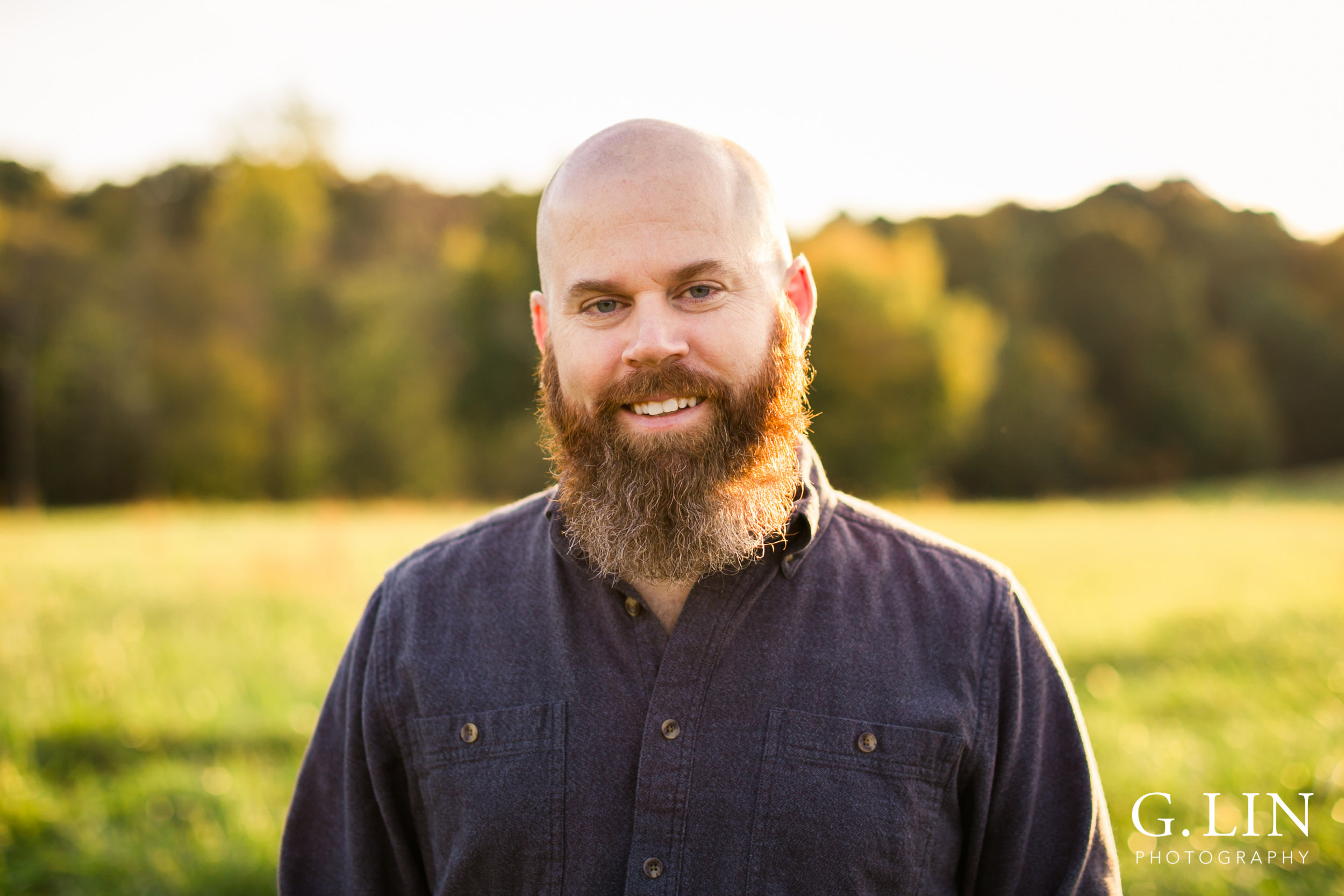 Good head shot of man in open field | Raleigh Family Photographer | G. Lin Photography