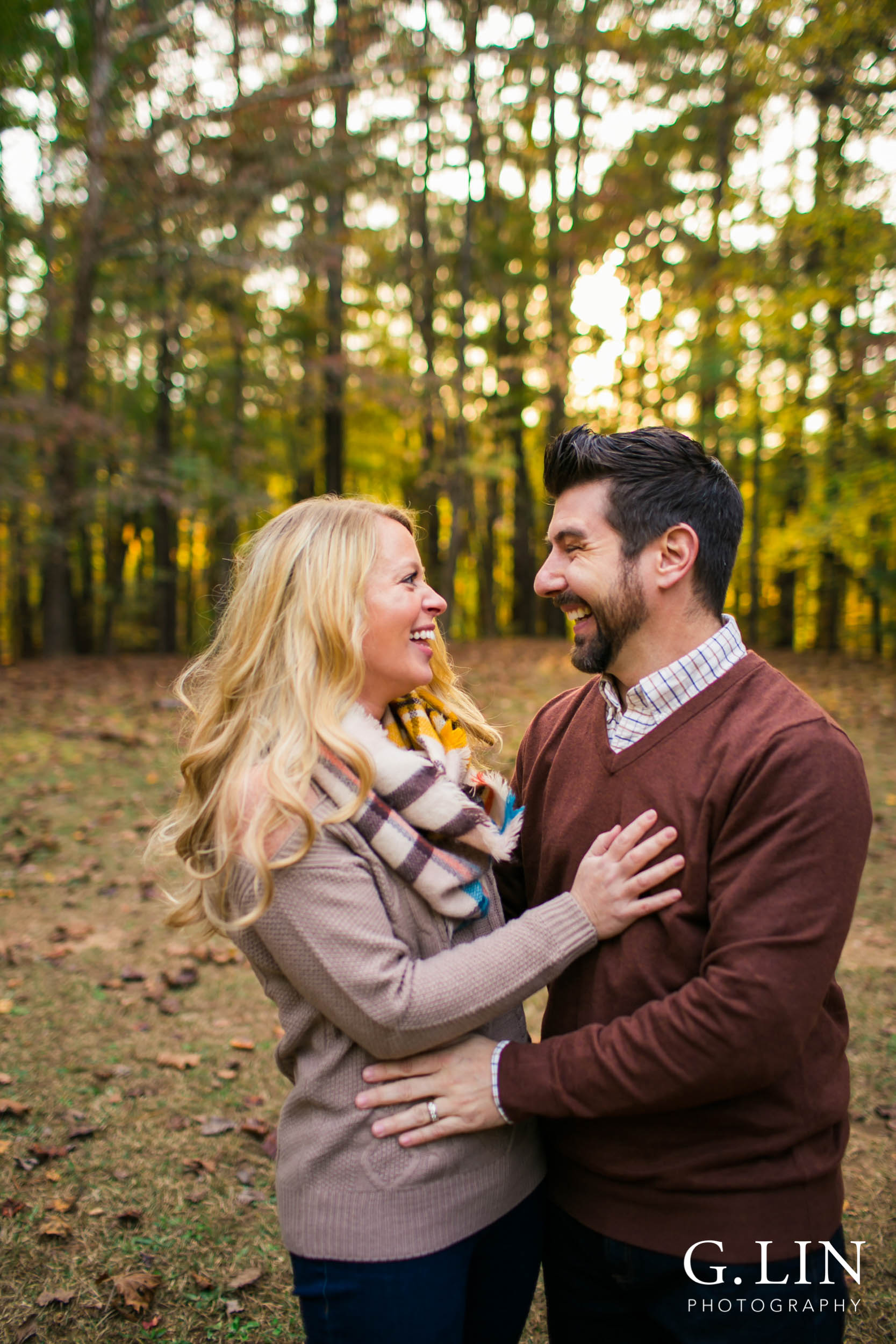Raleigh Family Photographer | G. Lin Photography | Couple laughing together at Umstead park