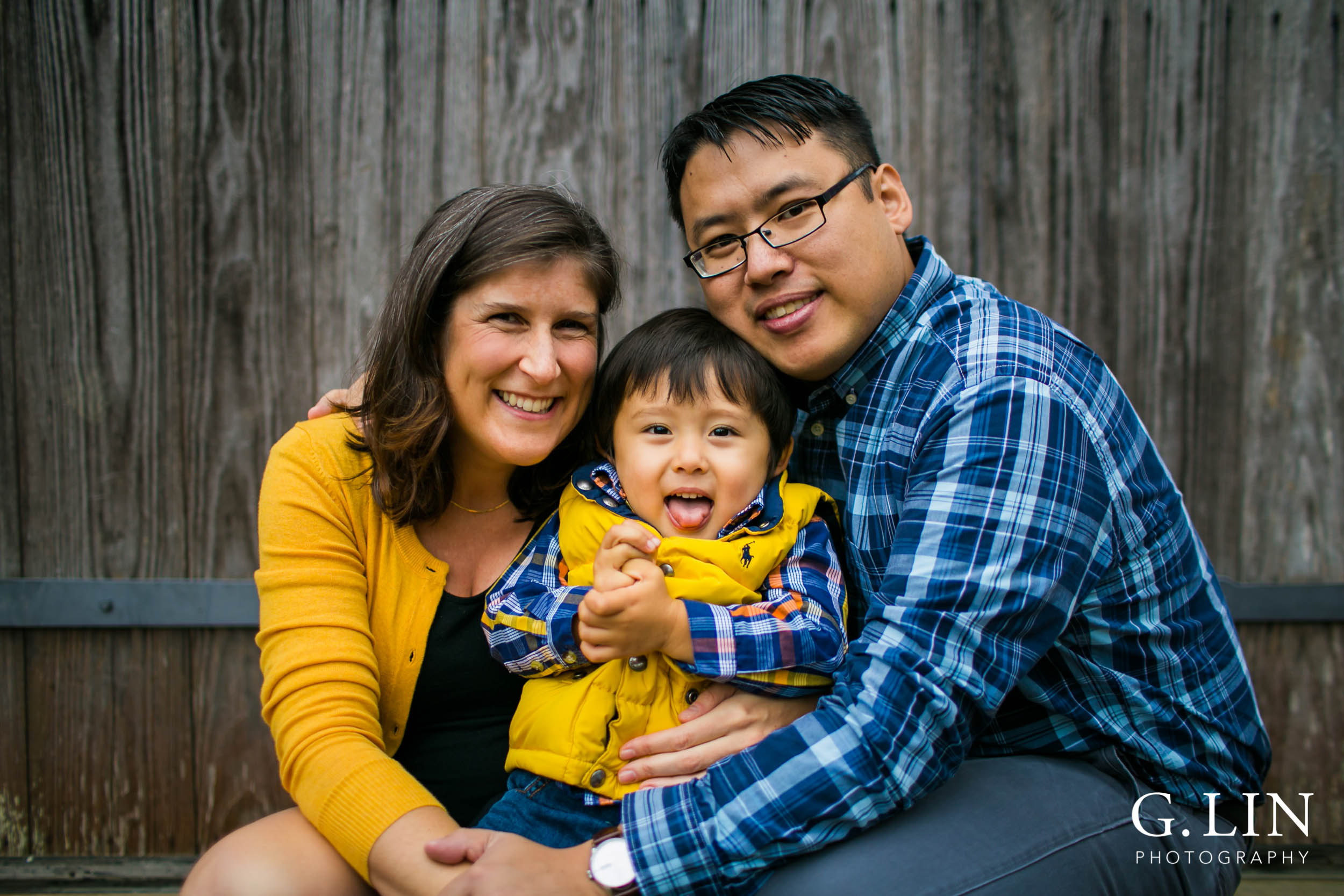 Durham Family Photography | G. Lin Photography | Family of three taking a candid photo