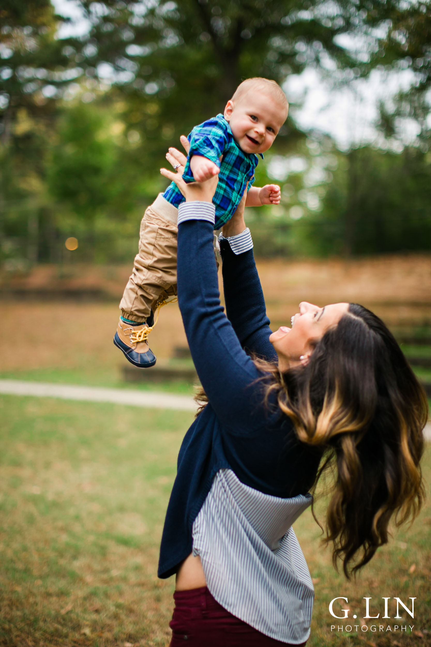 Raleigh Lifestyle Newborn Photography | G. LIn photography | Mom tossing baby boy in the air