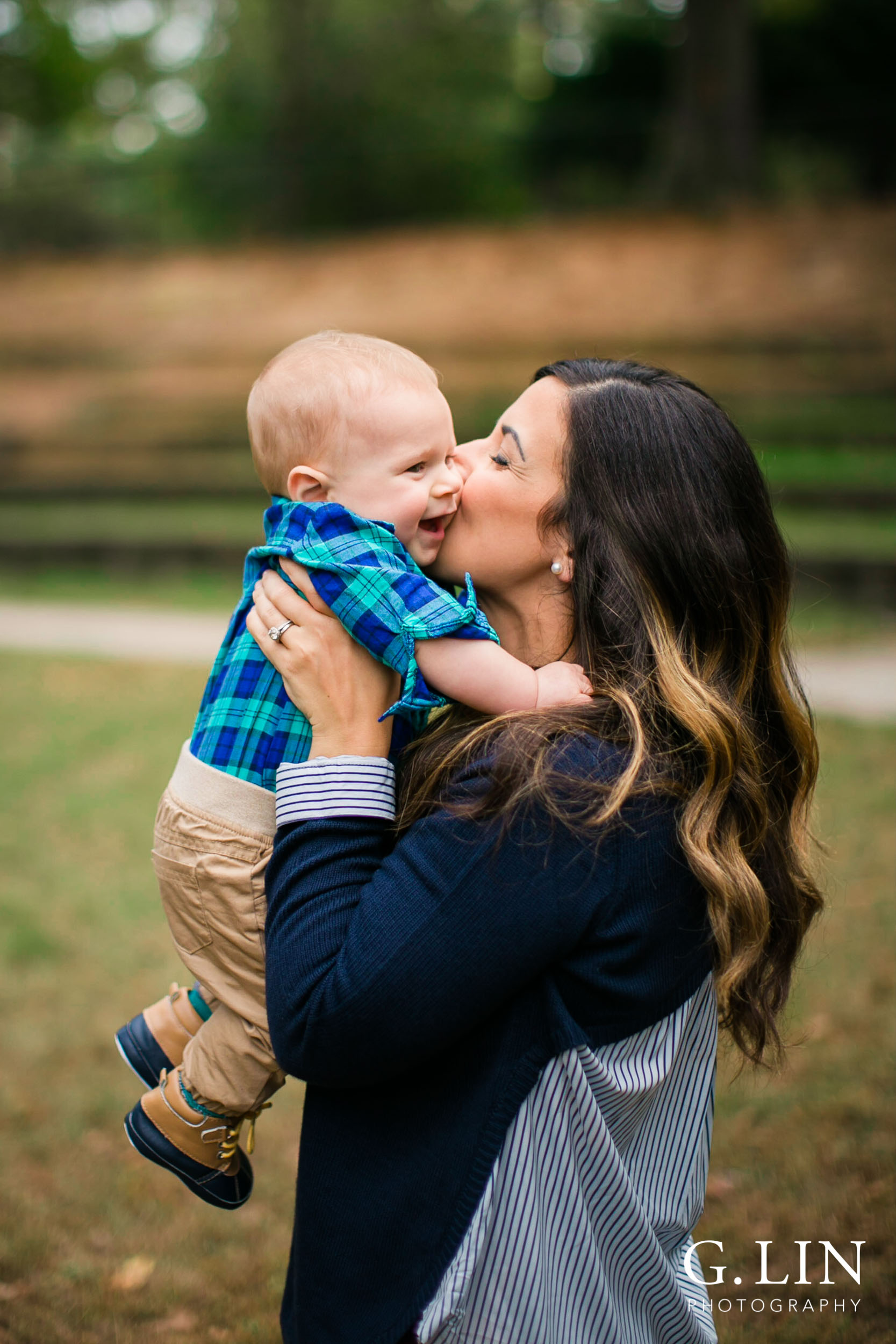 Raleigh Newborn Photographer | G. Lin Photography | Mom kissing baby boy at park