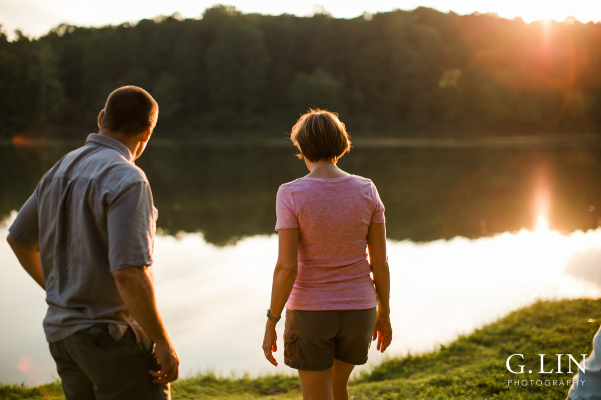 Raleigh Family Photographer | By G. Lin Photography | Candid photo of parents by the lake