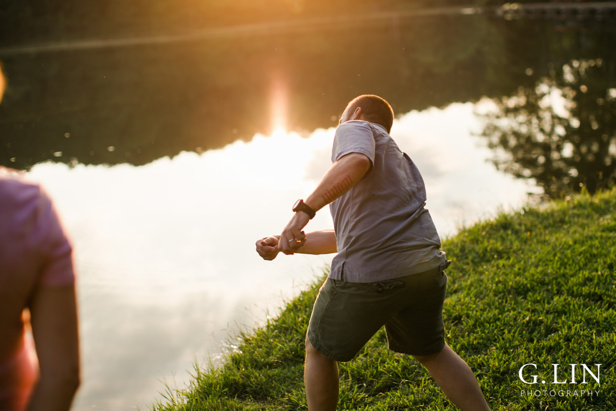 Raleigh Family Photographer | By G. Lin Photography | Dad skipping rocks on water