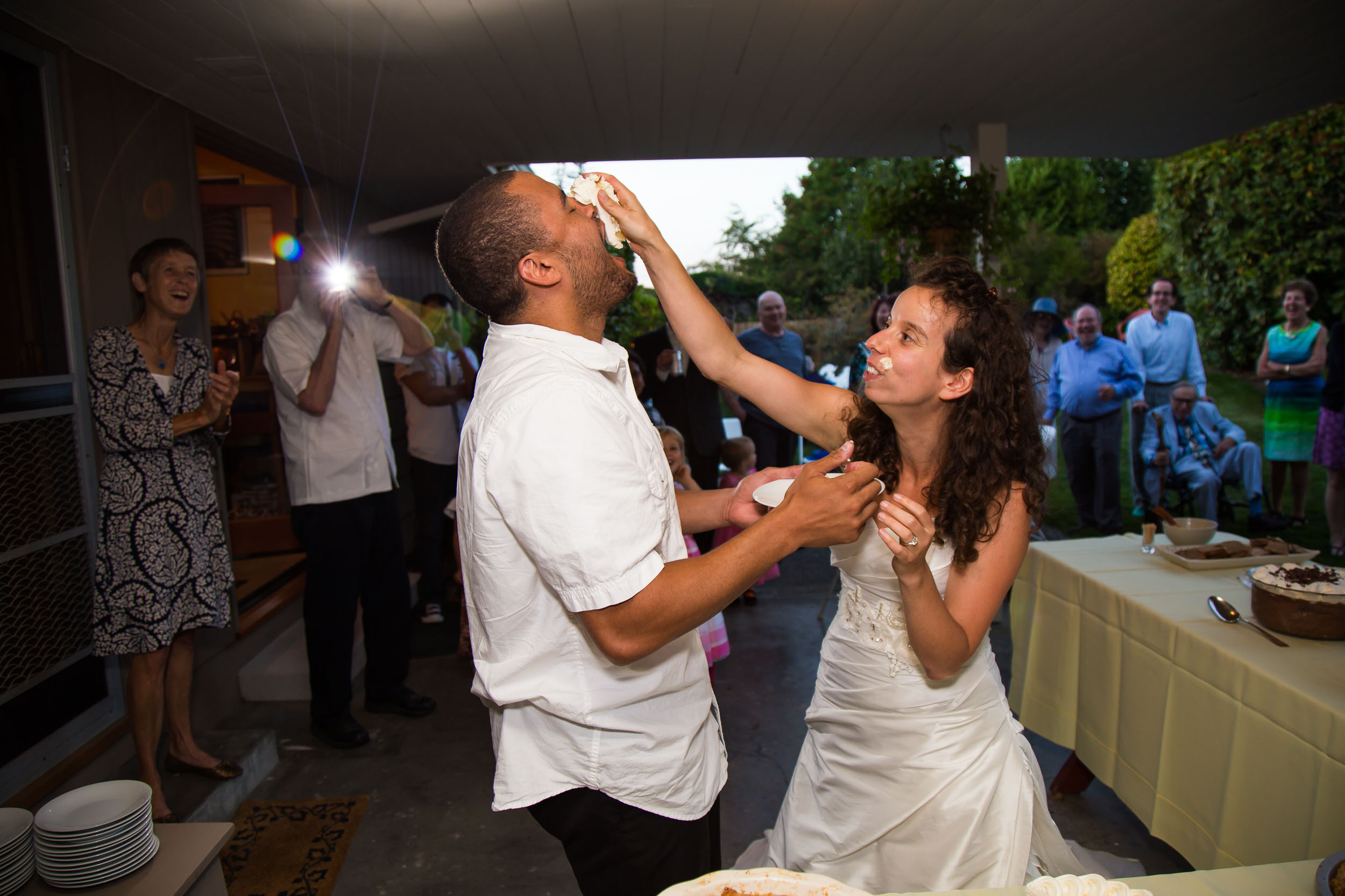 Bride smashing cake on groom's face | Durham Wedding Photographer | By G. Lin Photography