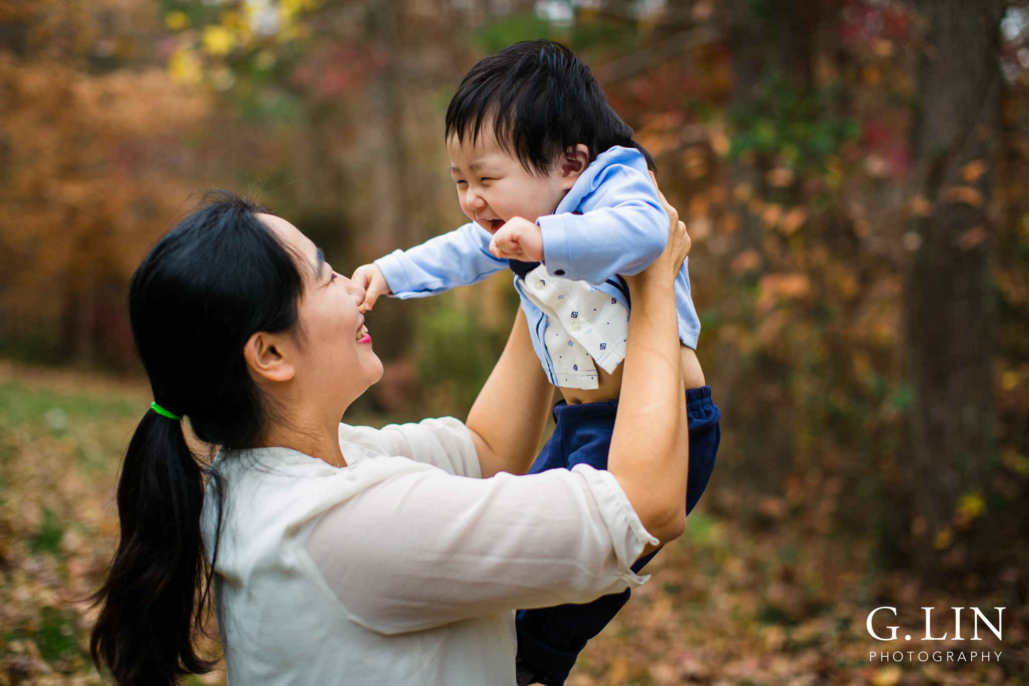 Durham Family Photographer   Mom playing with baby boy outside   By G. Lin Photography