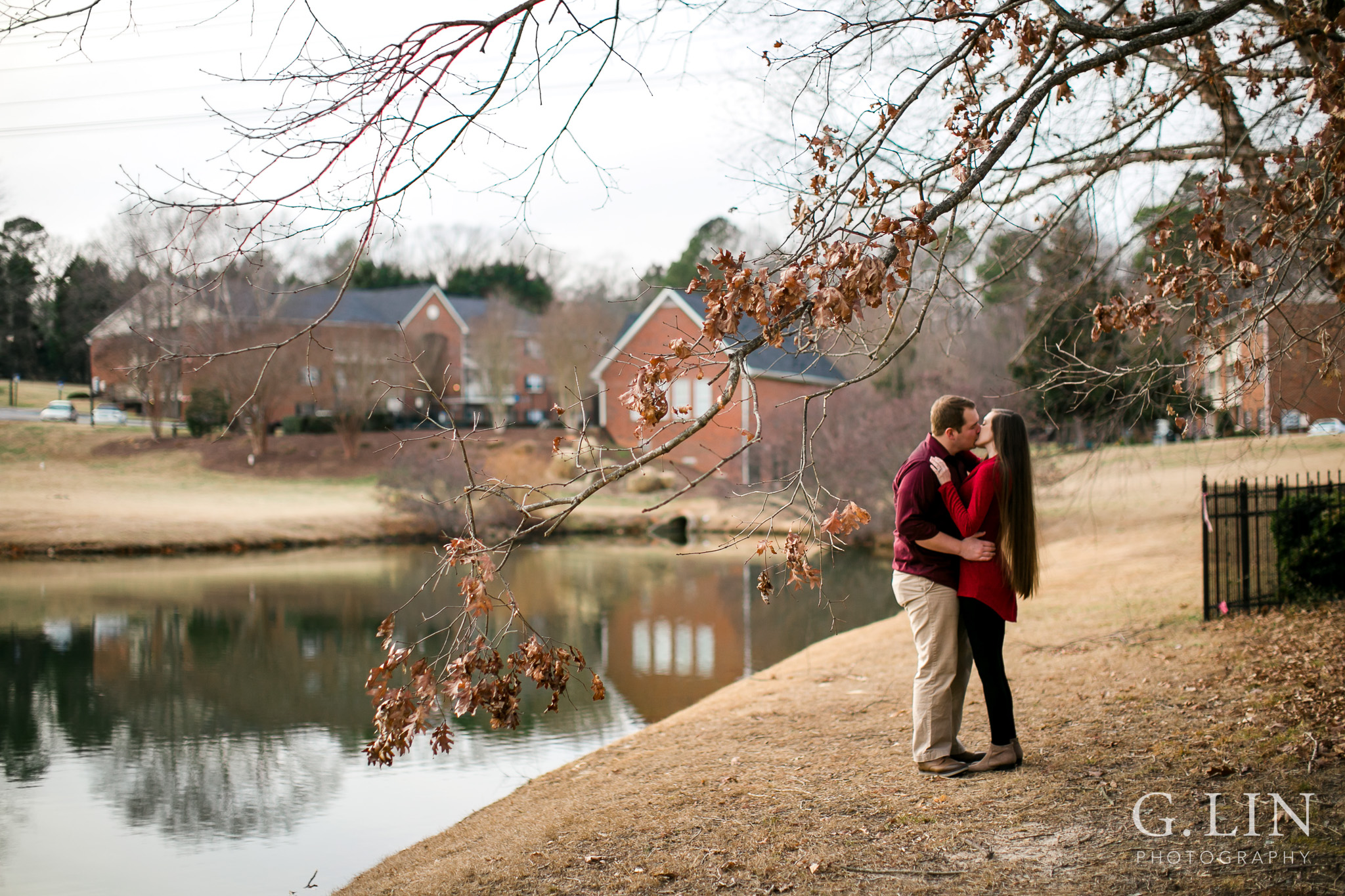 Winter engagement photo outside by tree | Raleigh Engagement Photographer | By G. Lin Photography