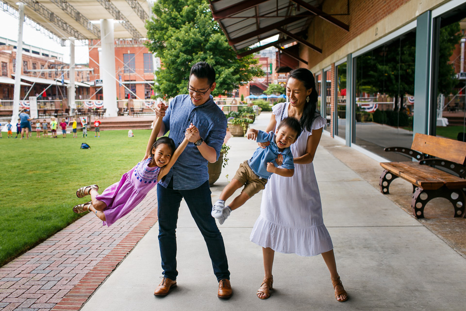 Parents swinging children | Downtown Durham Photography | By G. Lin Photography