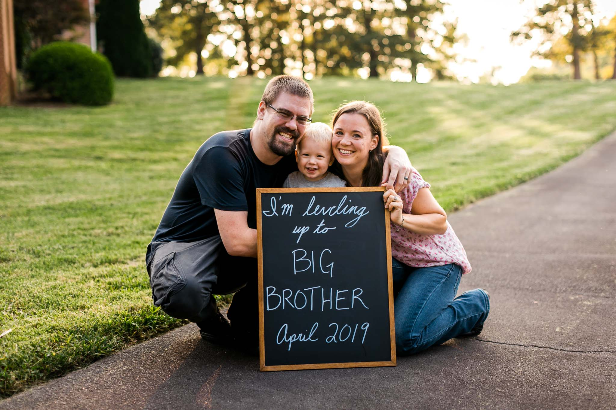 Pregnancy announcement with family and chalkboard | Gamer Dad | By G. Lin Photography | Rougemont Family Photographer
