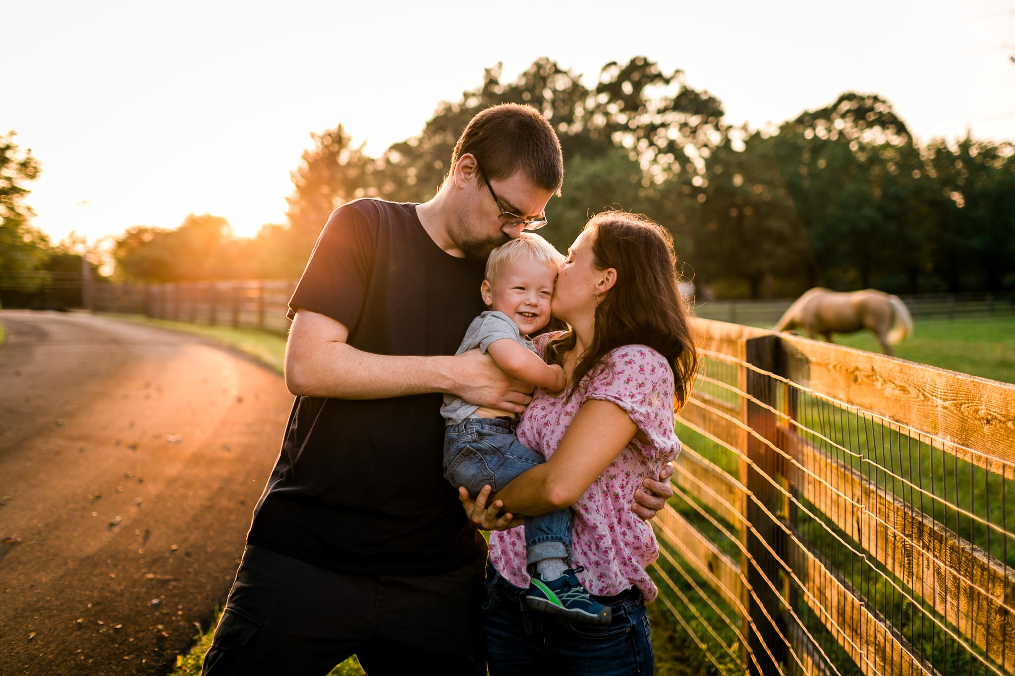 Parents kissing son on cheeks | By G. Lin Photography | Durham Rougemont Photographer