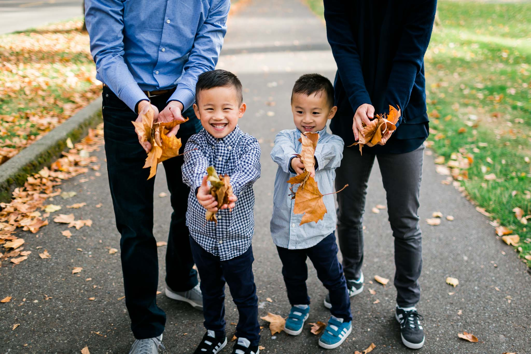 Boys holding leaves | Seattle Family Photographer | By G. Lin Photography