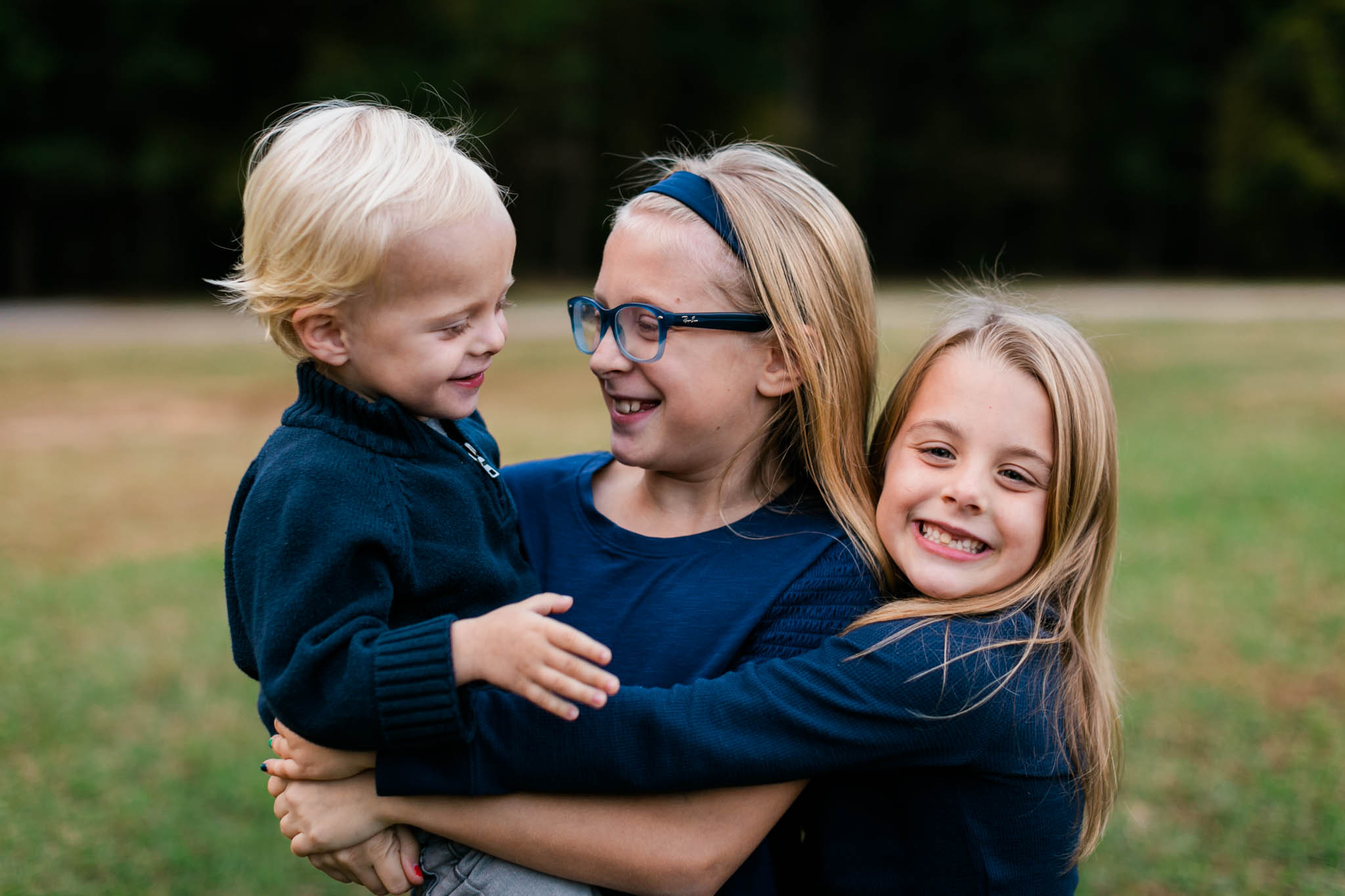 Sibling photo of three children at Umstead Park | Raleigh Family Photography | By G. Lin Photography