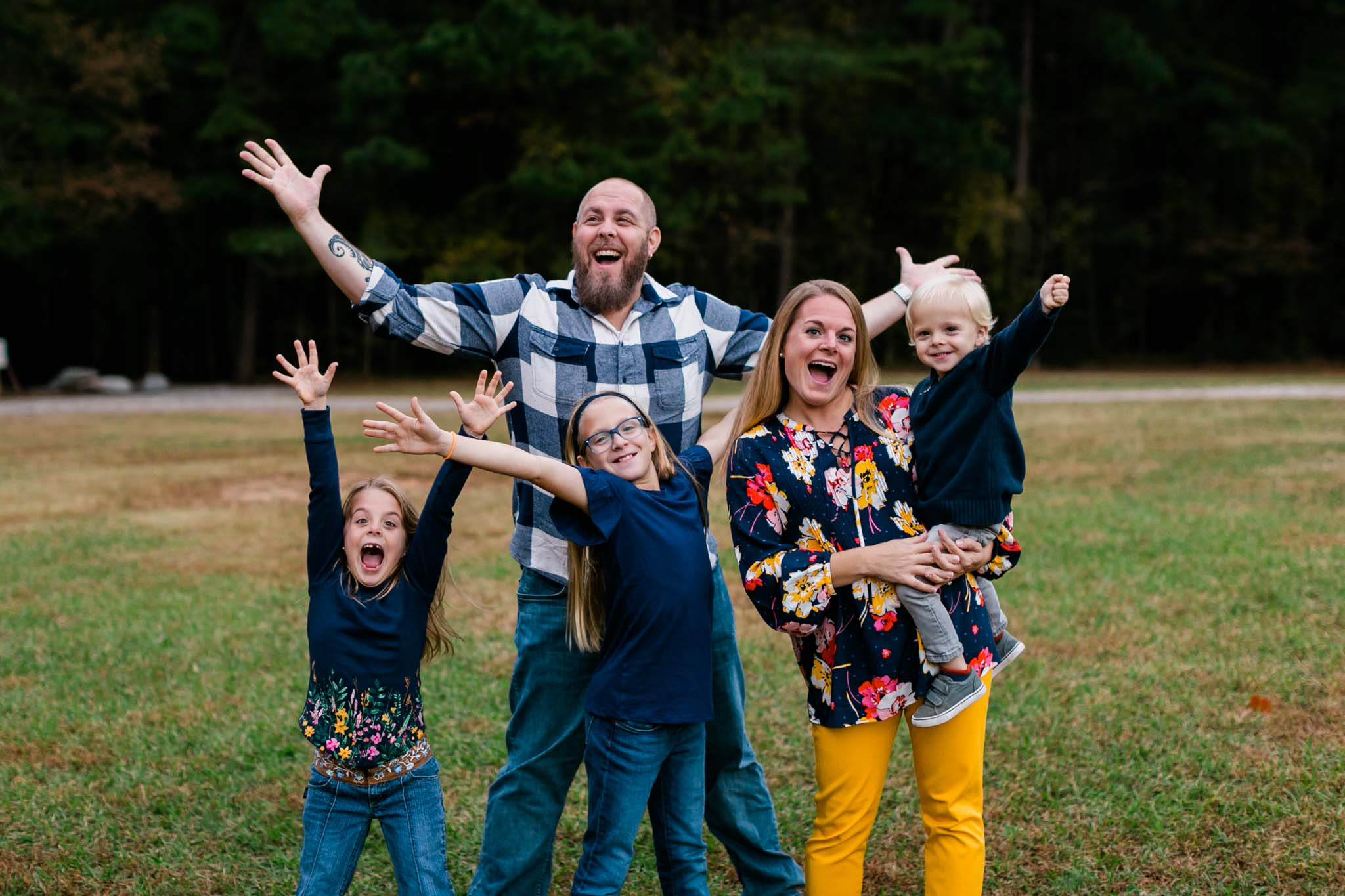 Candid photo of family laughing at Umstead Park | Raleigh Family Photographer | By G. Lin Photography