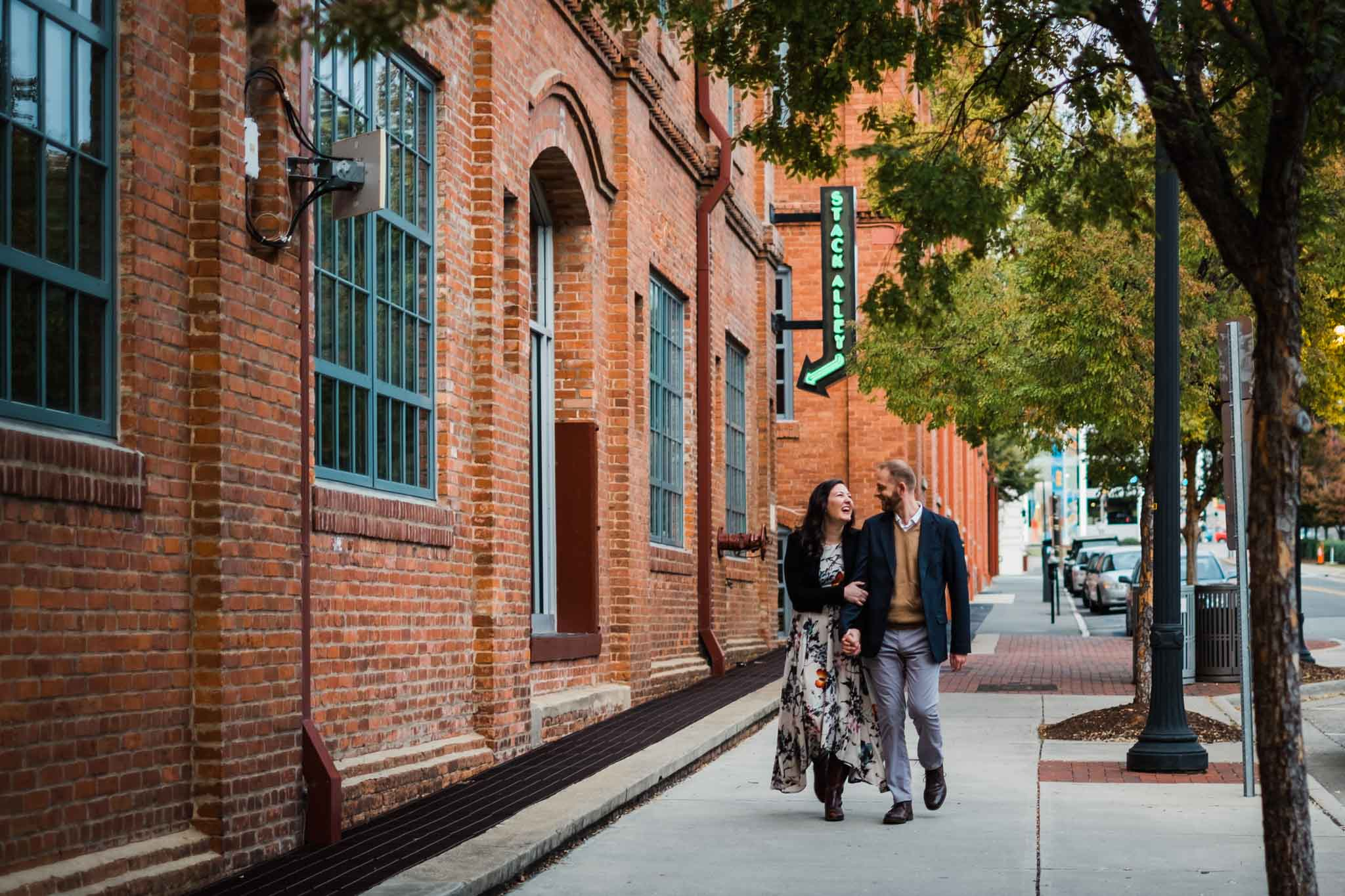 Couple walking down sidewalk at American Tobacco Campus | Durham Photographer | By G. Lin Photography
