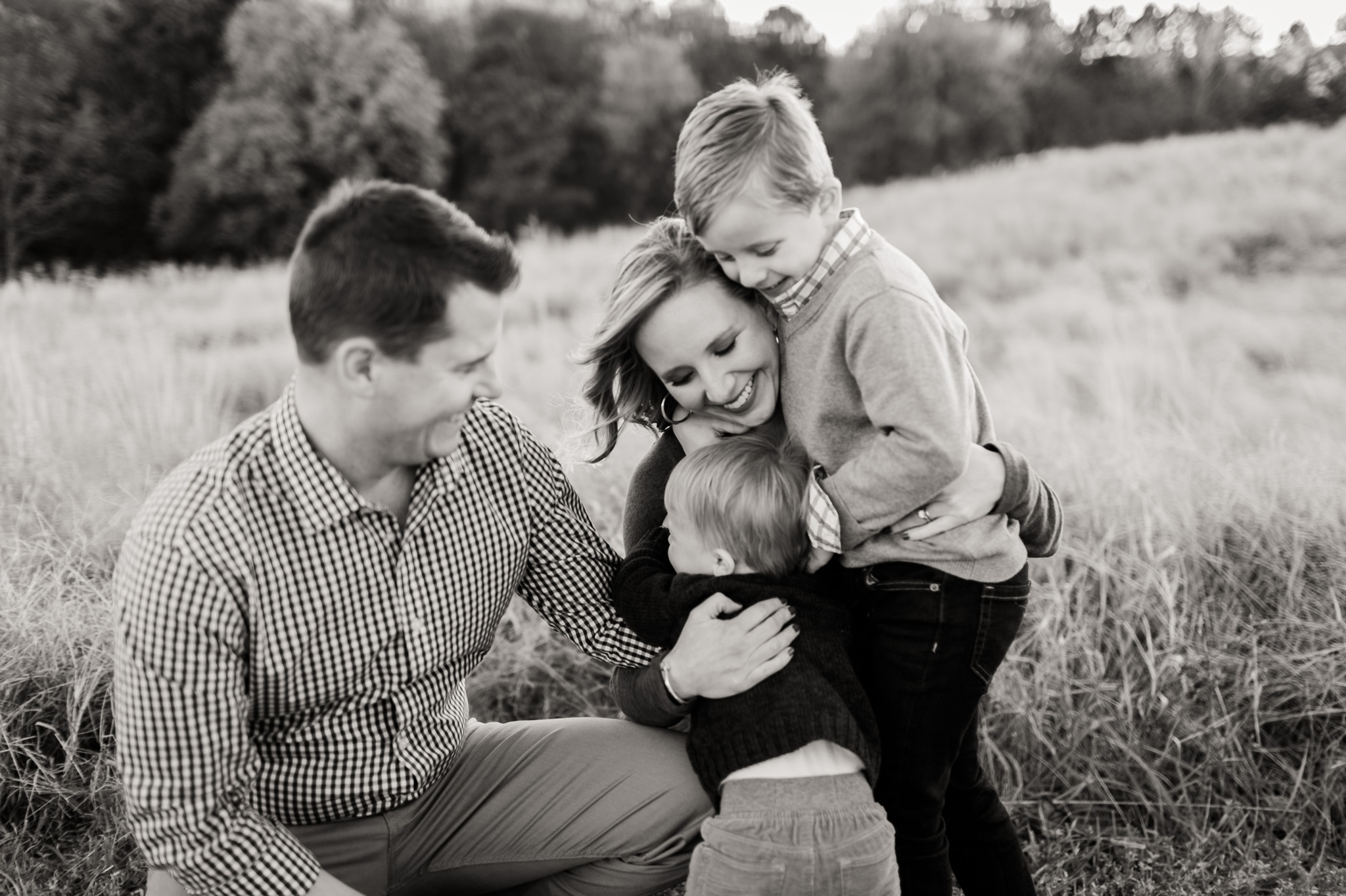 Black and white photo of family smiling outside  at NCMA | Raleigh Family Photographer | By G. Lin Photography