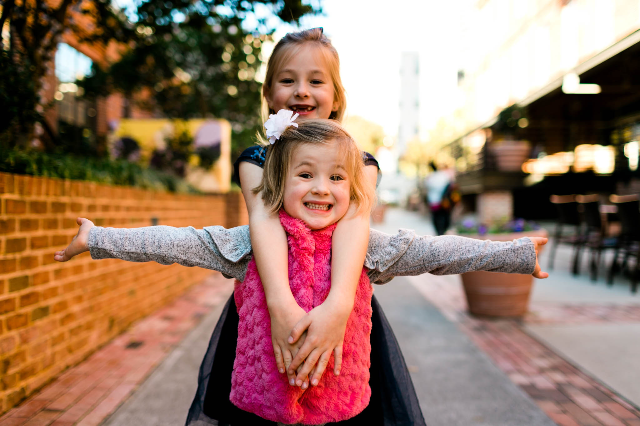Children smiling at the American Tobacco Campus | Durham Family Photographer | By G. Lin Photography