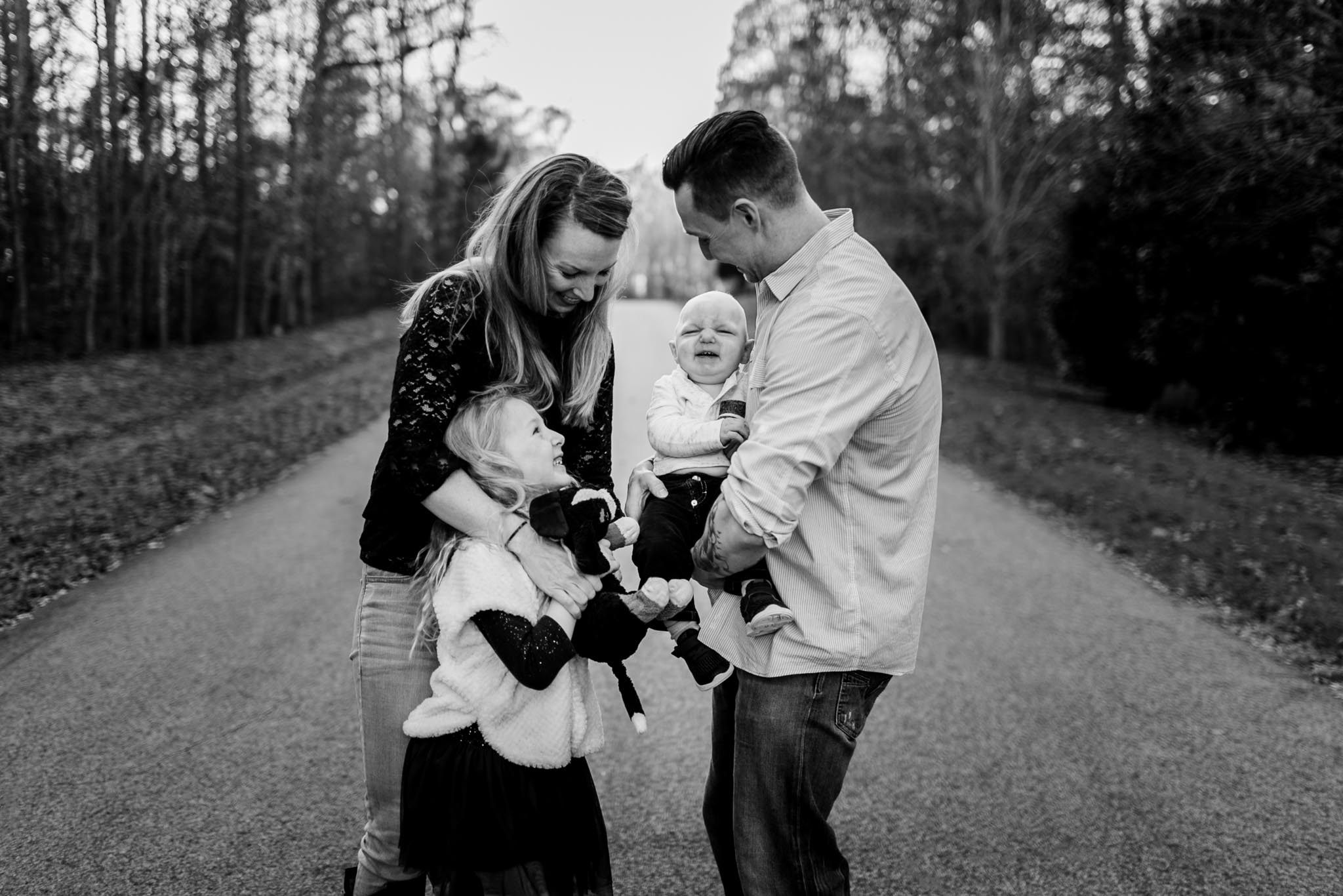Candid black and white family photo | By G. Lin Photography | Raleigh Photographer