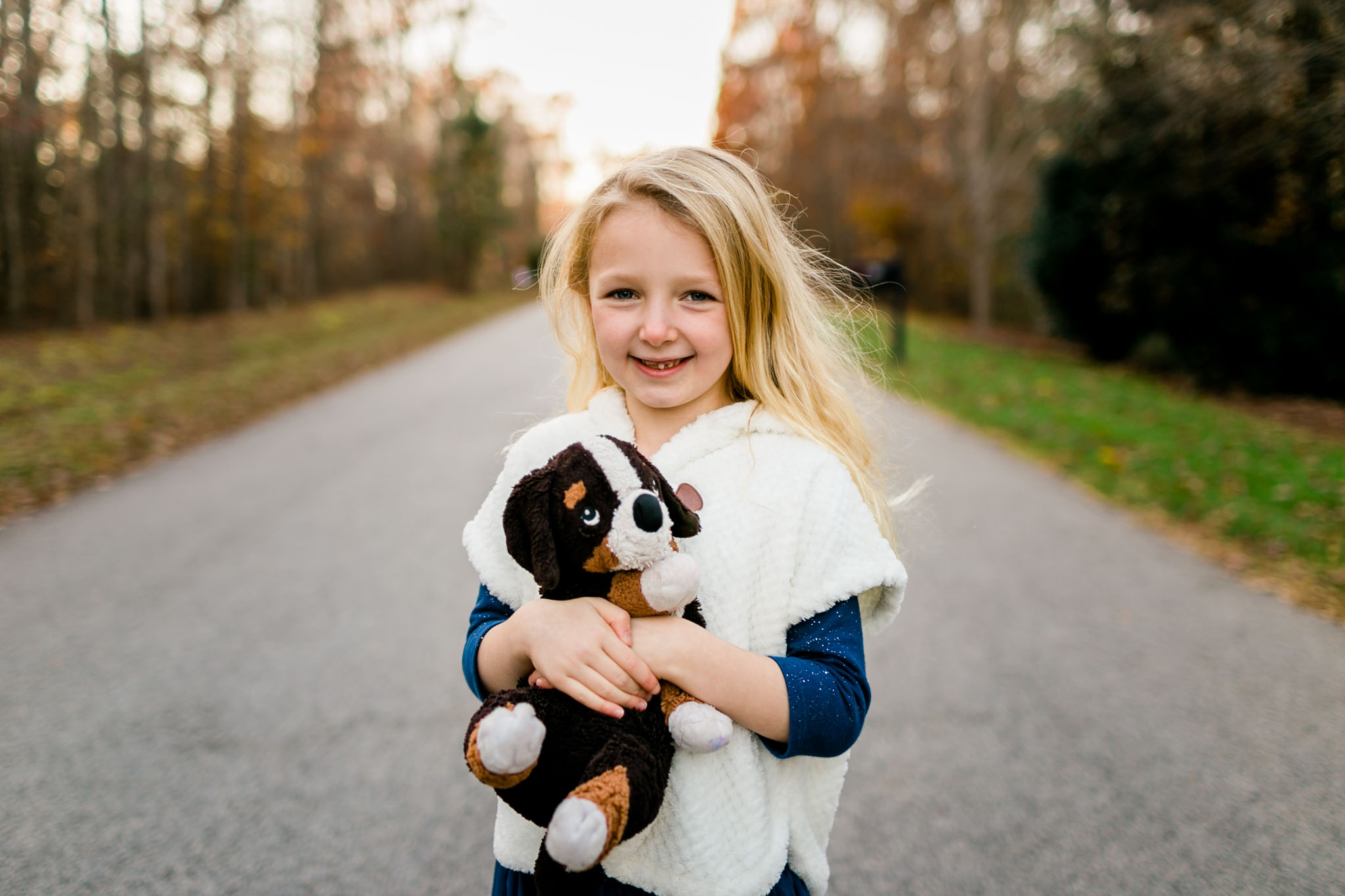 Outdoor portrait of little girl smiling | By G. Lin Photography | Raleigh Family Photographer