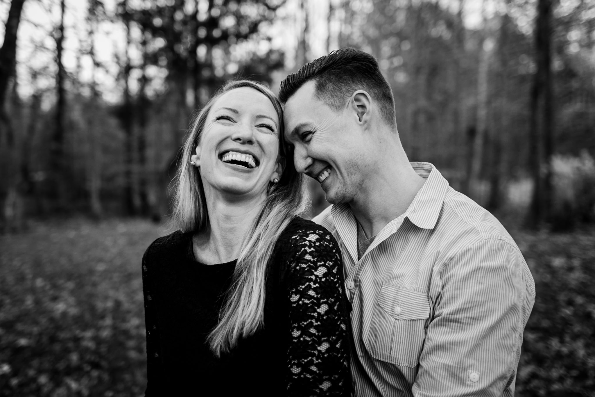 Black and white outdoor portrait of couple laughing   Durham Photographer   By G. Lin Photography