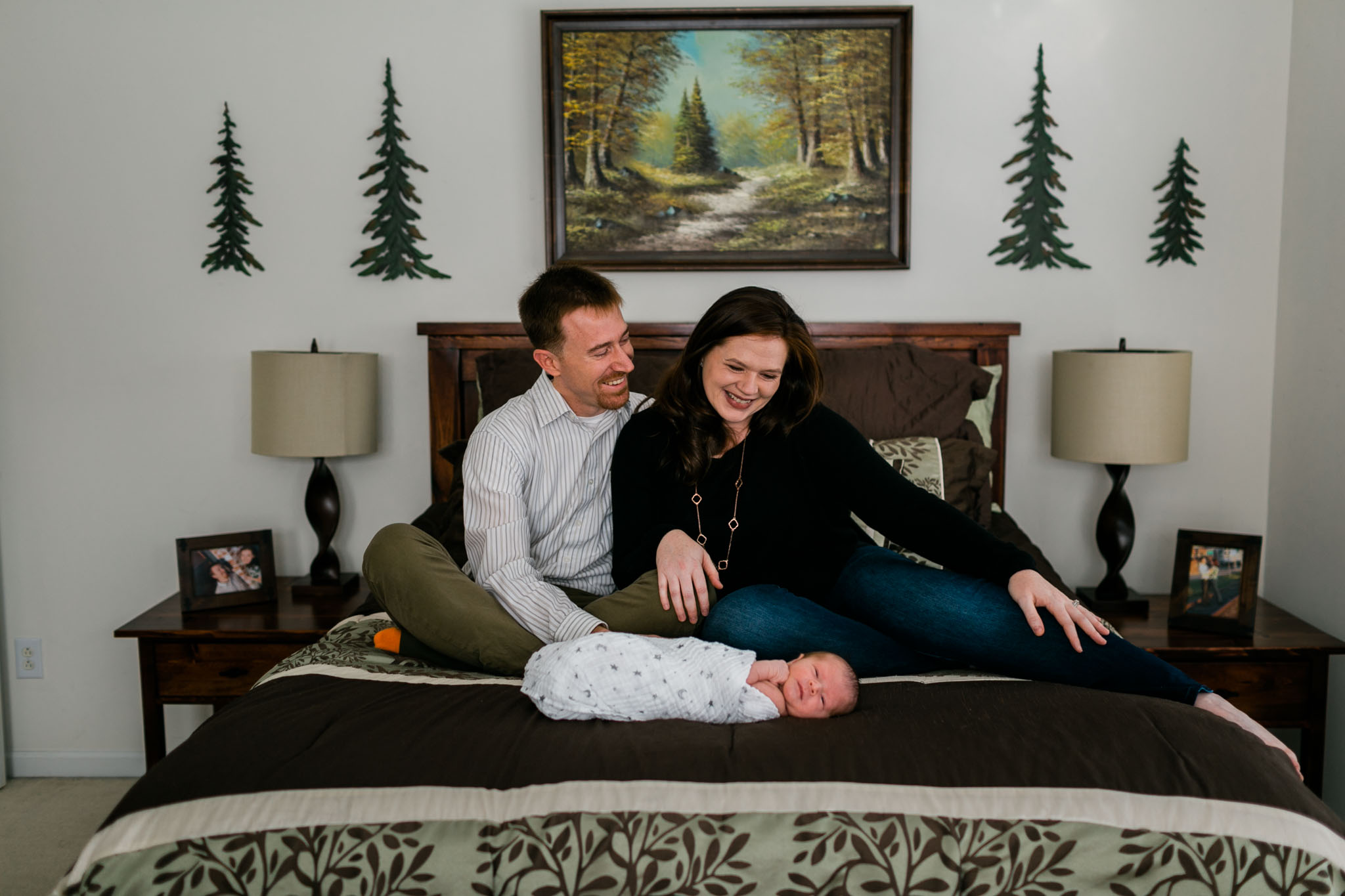 Couple sitting on bed with baby | Raleigh Newborn Photographer | By G. Lin Photography