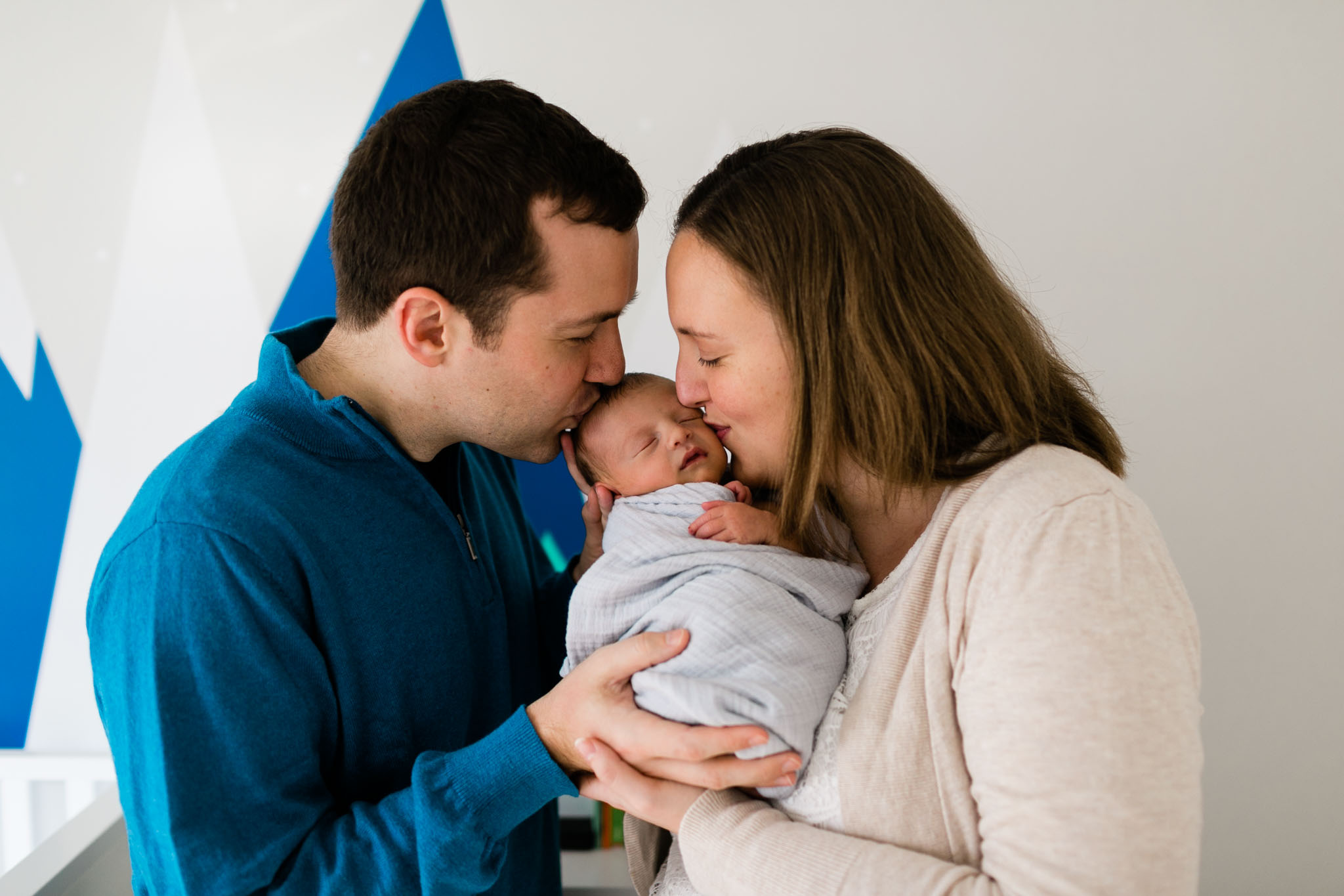 Parents kissing baby on face | Newborn Photographer in Raleigh NC | By G. Lin Photography