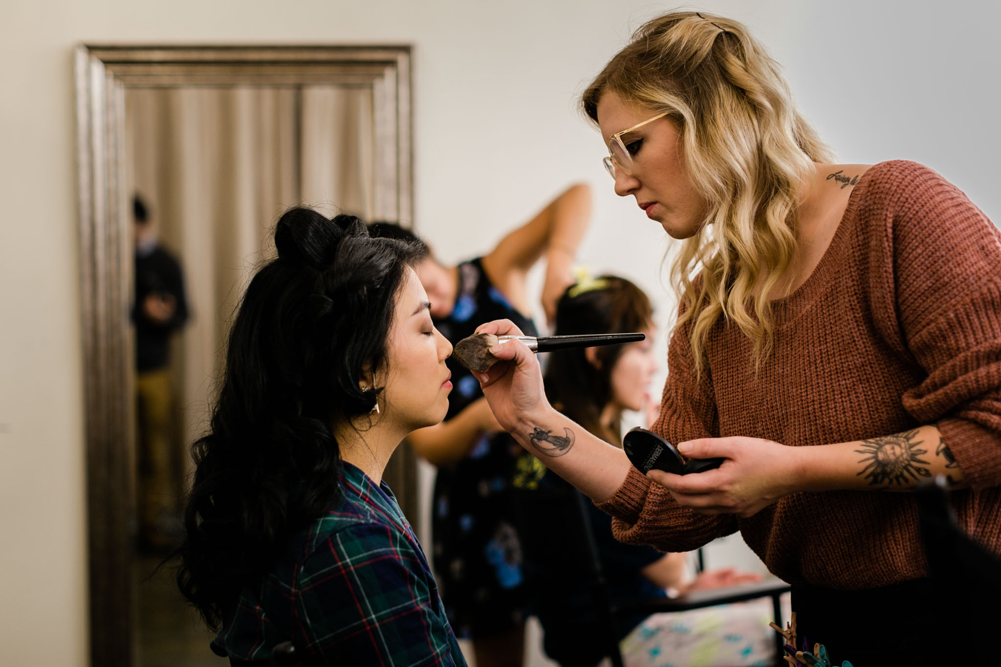 Bride getting makeup done at The Cotton Room | Durham Wedding Photographer | By G. Lin Photography