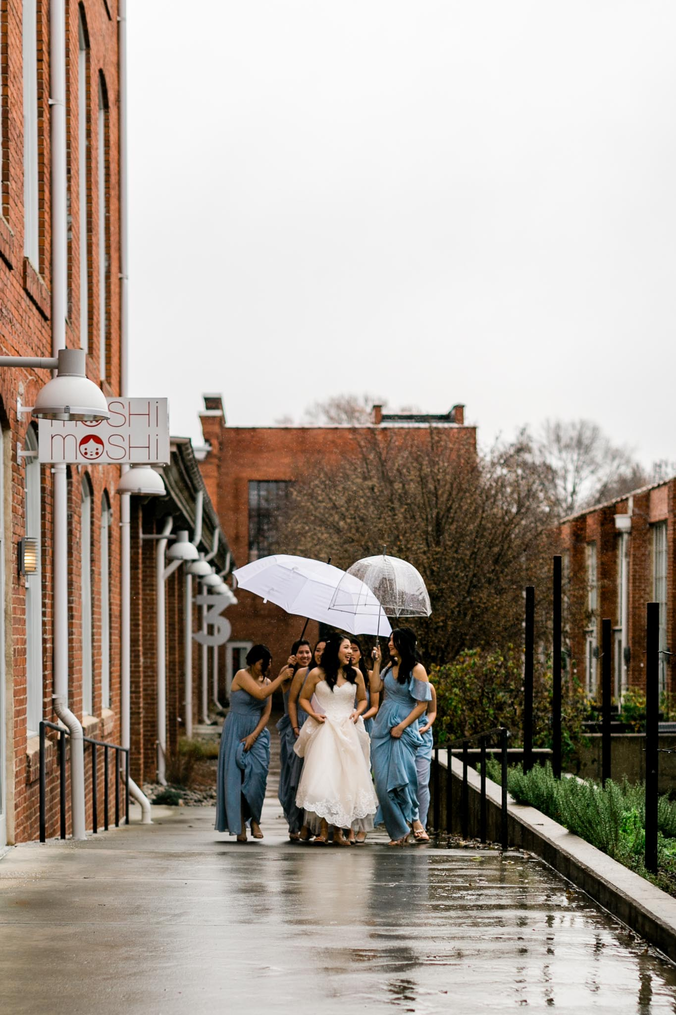 Bridal party walking in the rain at The Cotton Room | Durham Wedding Photographer | By G. Lin Photography