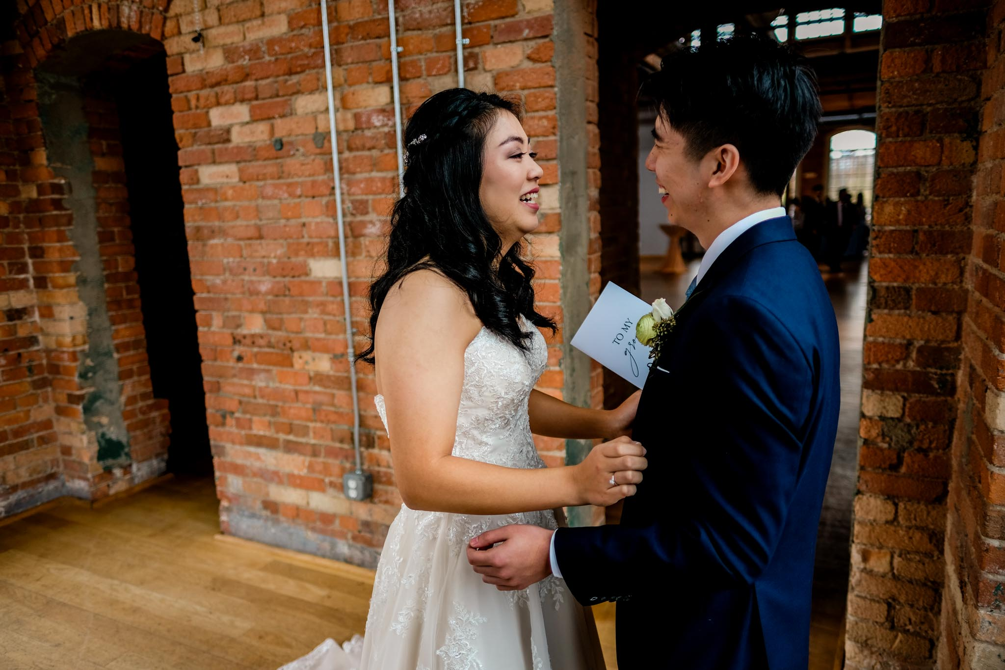Bride laughing with groom | The Cotton Room Wedding Photography | Durham NC | By G. Lin Photography