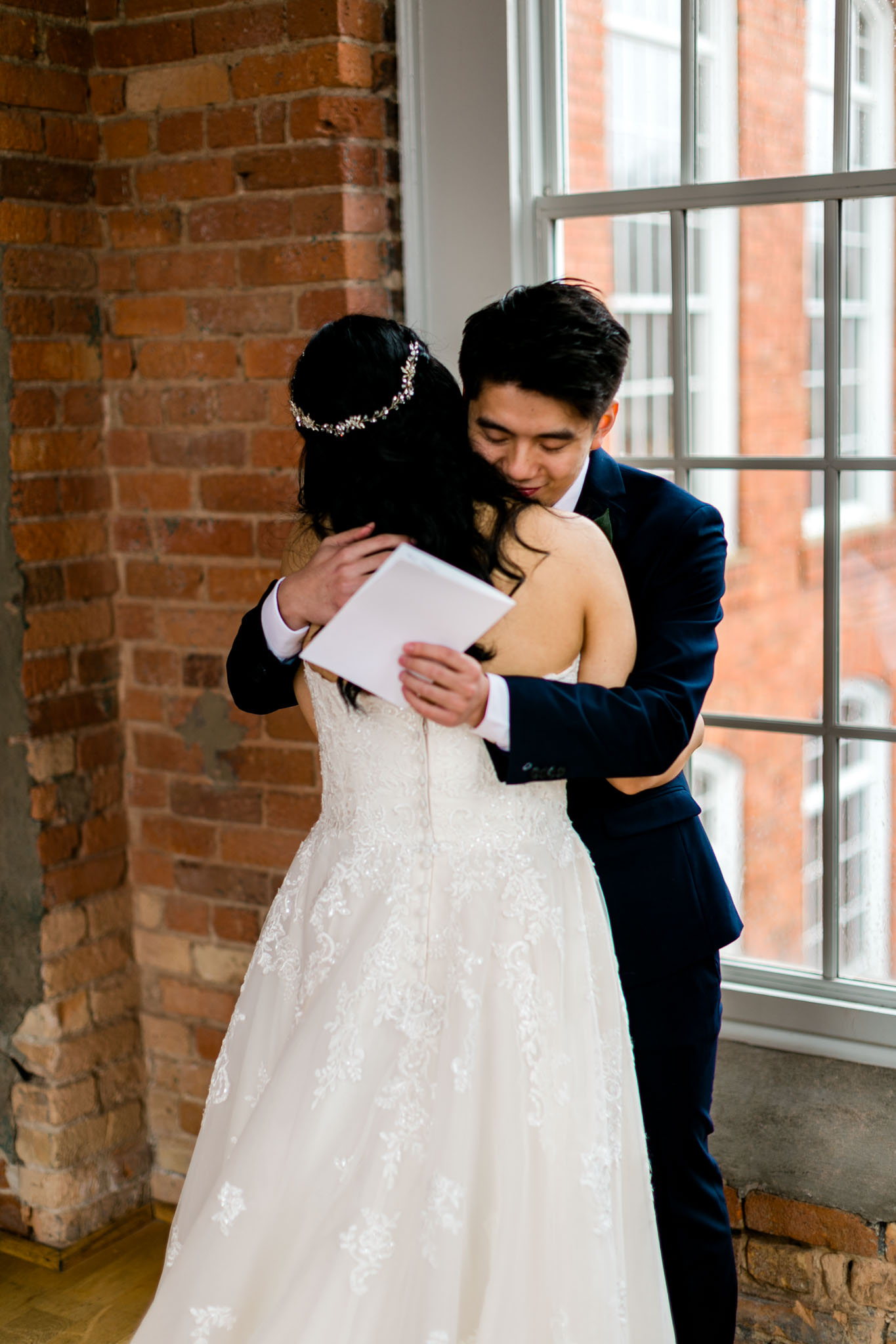 Groom hugging bride | Durham Wedding Photographer | The Cotton Room | By G. Lin Photography