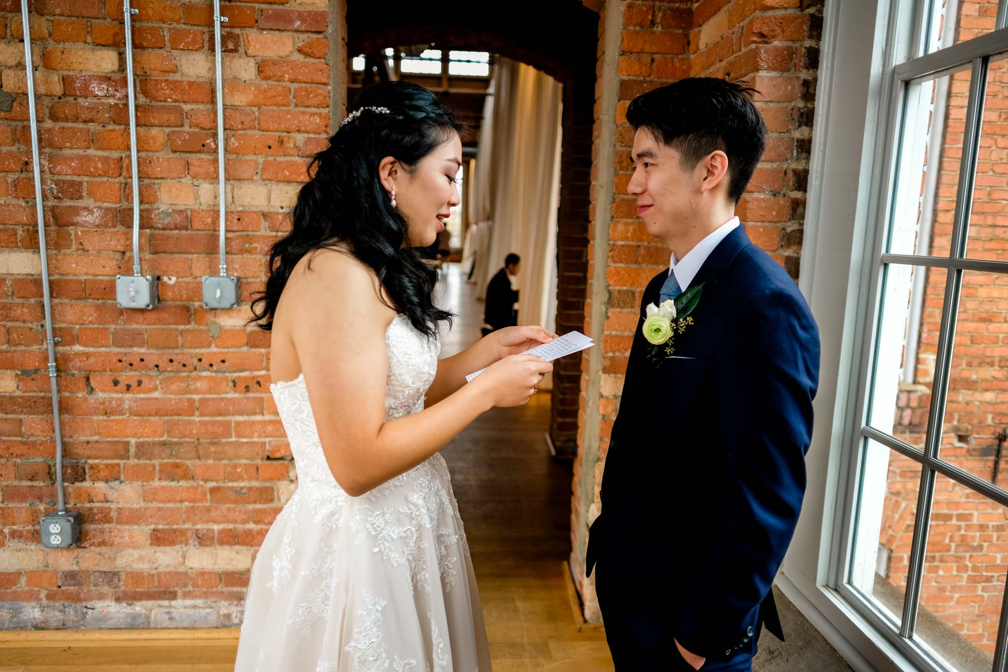 Bride reading letter to groom | The Cotton Room Wedding Photography | By G. Lin Photography | Durham NC