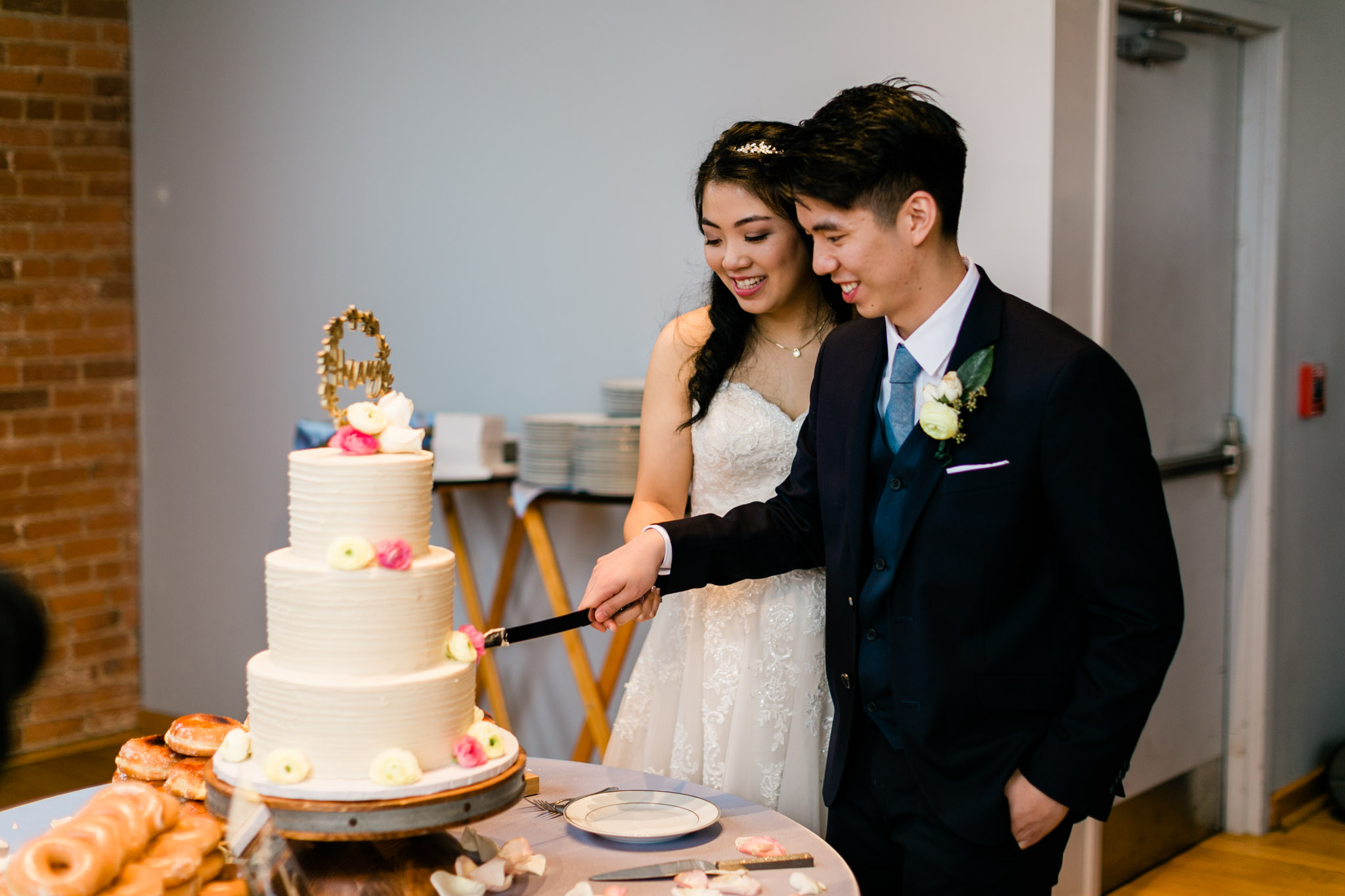 Bride and groom cutting the cake | Durham Wedding Photography | The Cotton Room | By G. Lin Photography