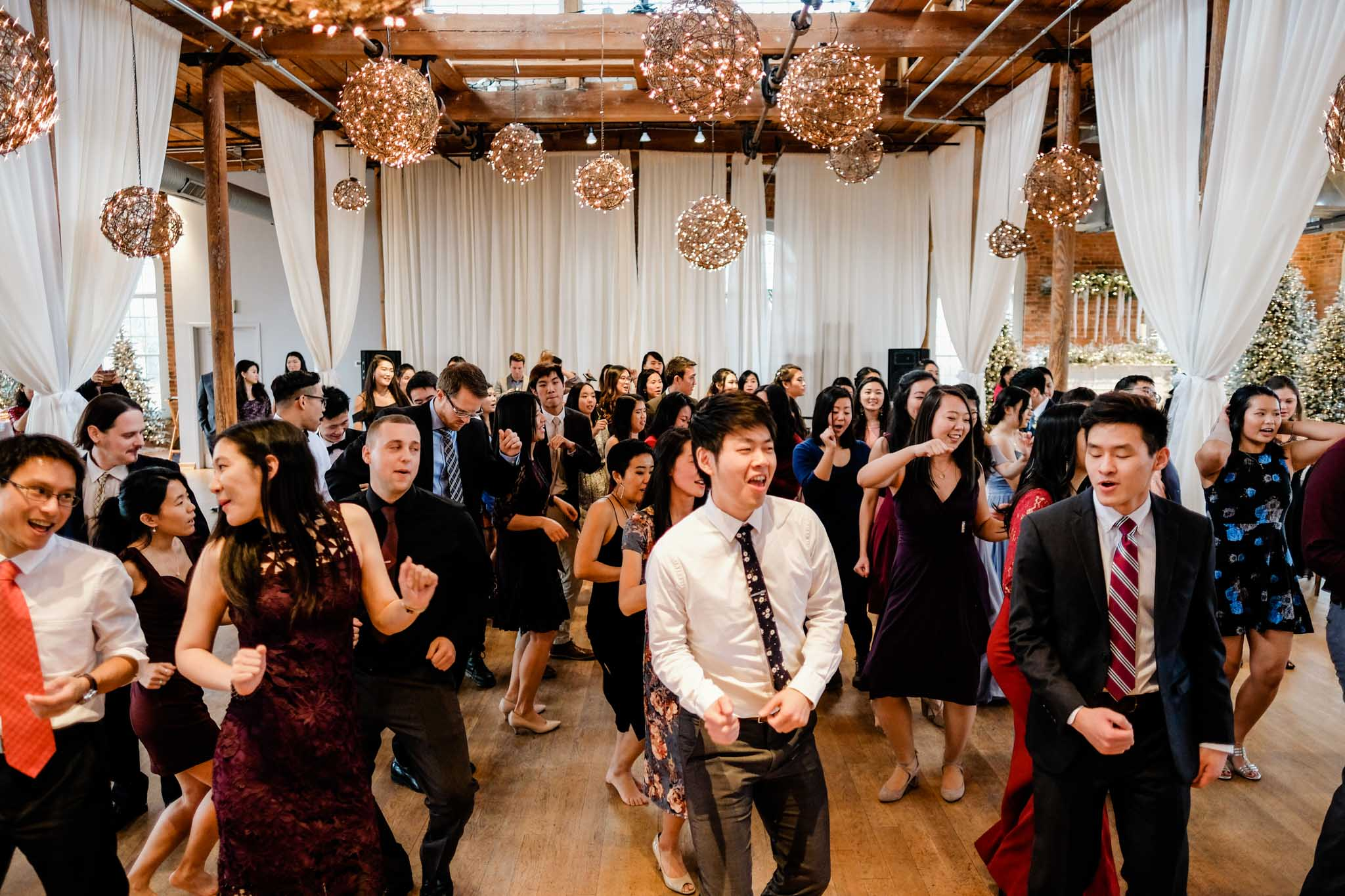 Dancing during wedding reception at The Cotton Room | Durham Event Photographer | By G. Lin Photography