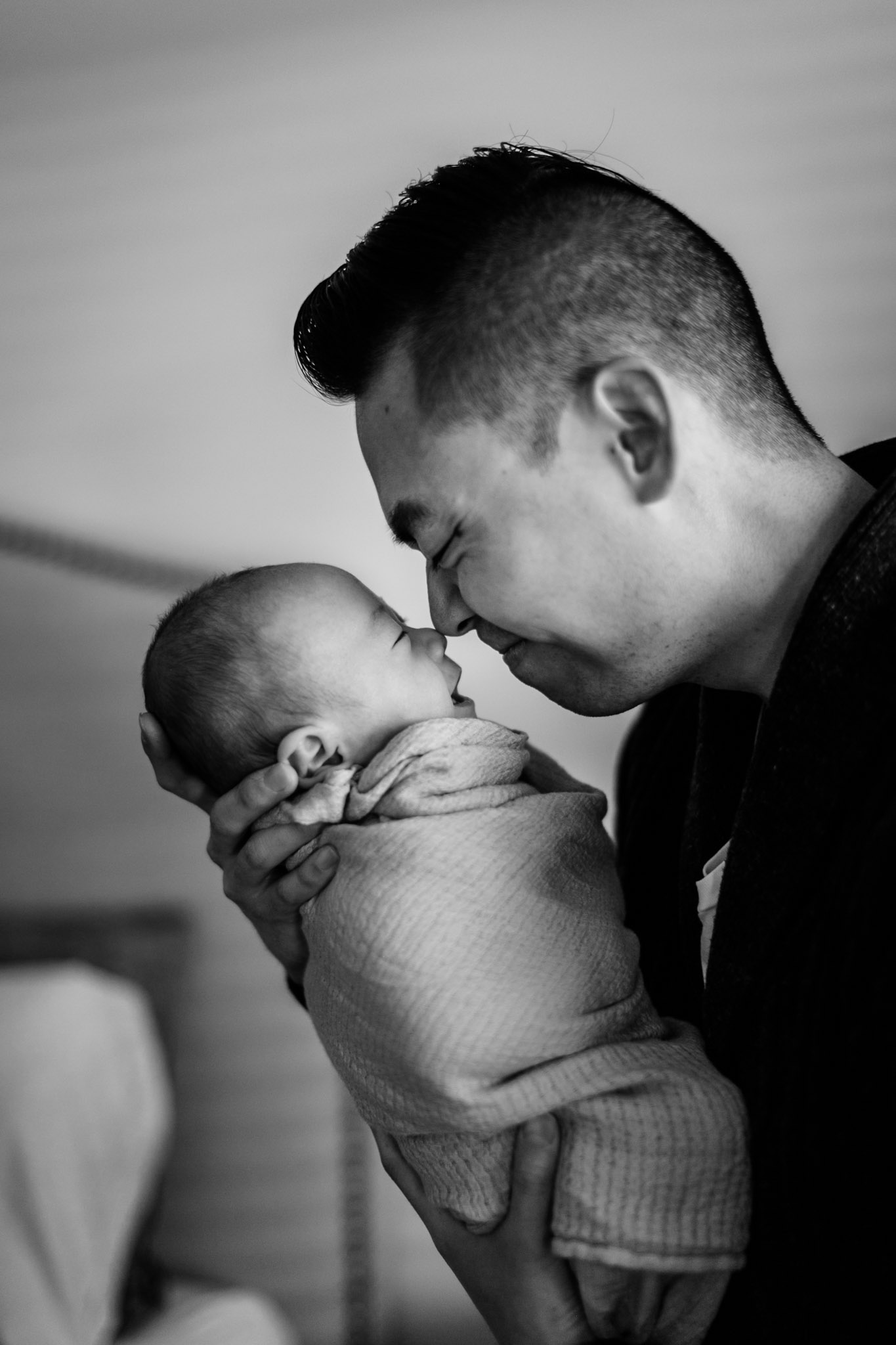 Black and white photo of father and son | Newborn Photographer in Durham NC | By G. Lin Photography