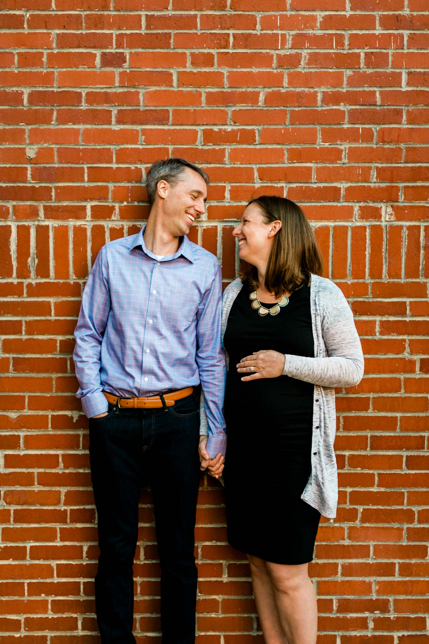 Candid photo of couple at American Tobacco Campus | Durham Newborn Photographer | By G. Lin Photography