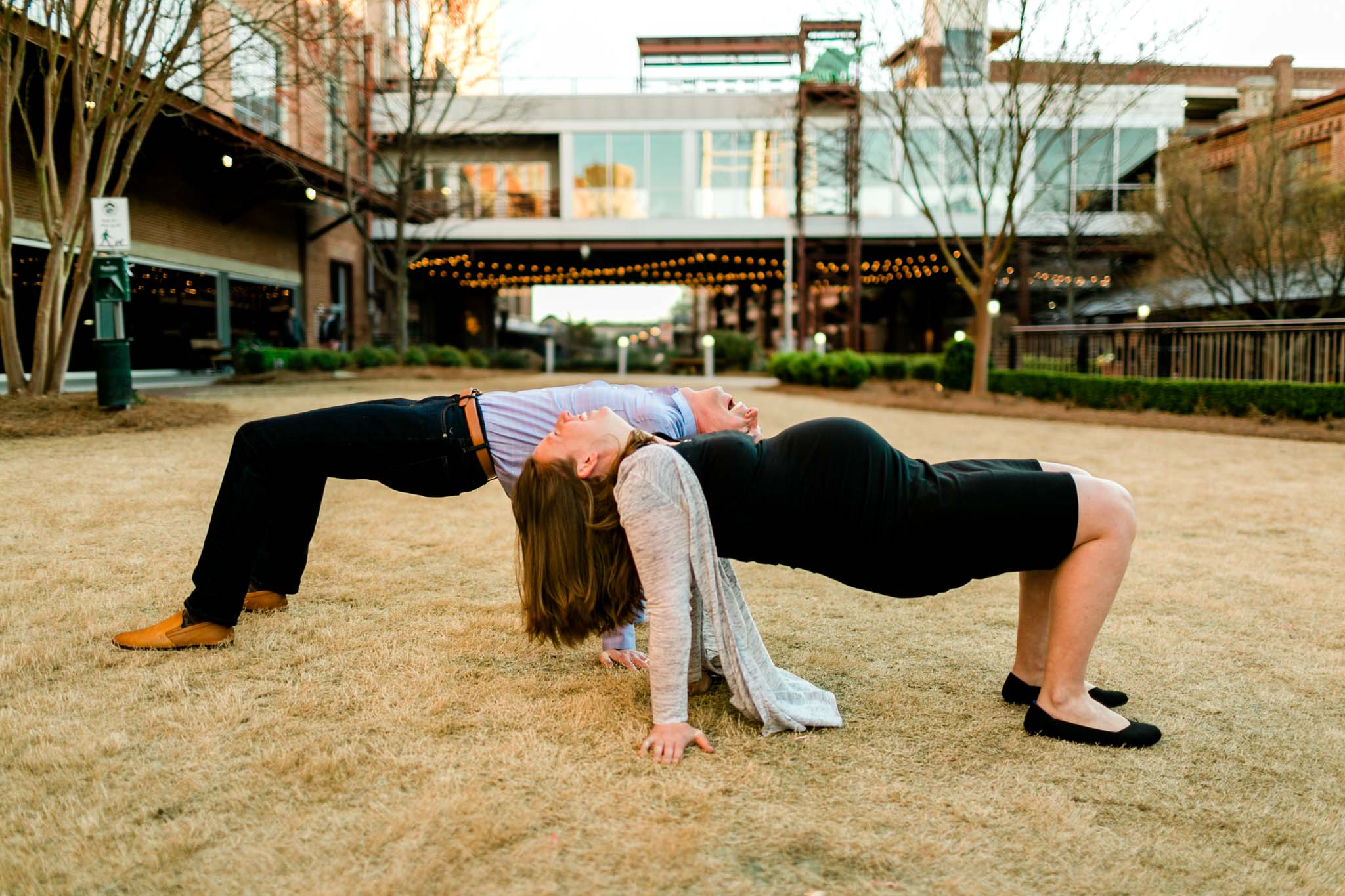 Couple doing a yoga pose at American Tobacco Campus   Durham Family Photographer   By G. Lin Photography