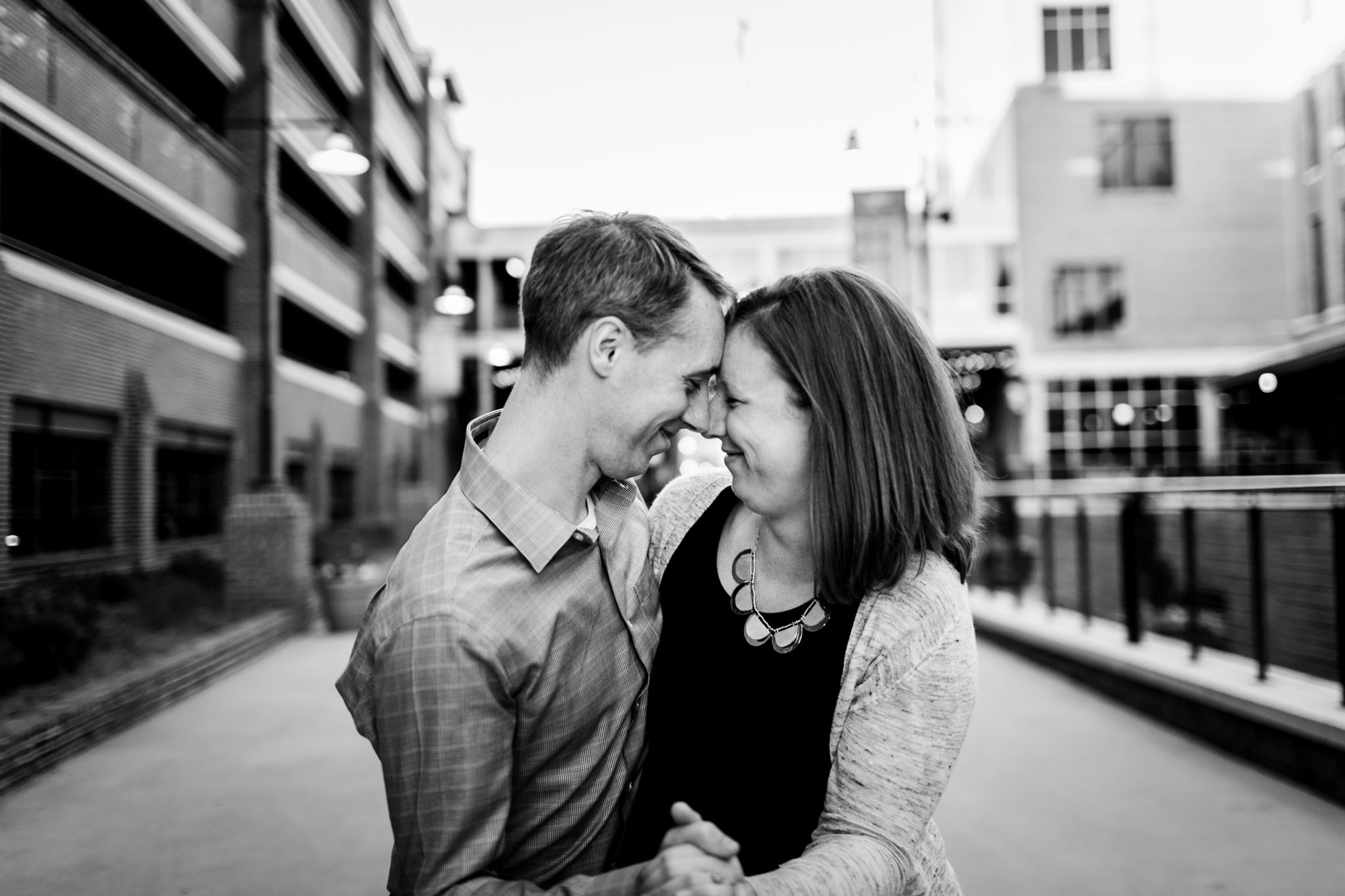 Durham Photographer   Couple dancing together at American Tobacco Campus   By G. Lin Photography