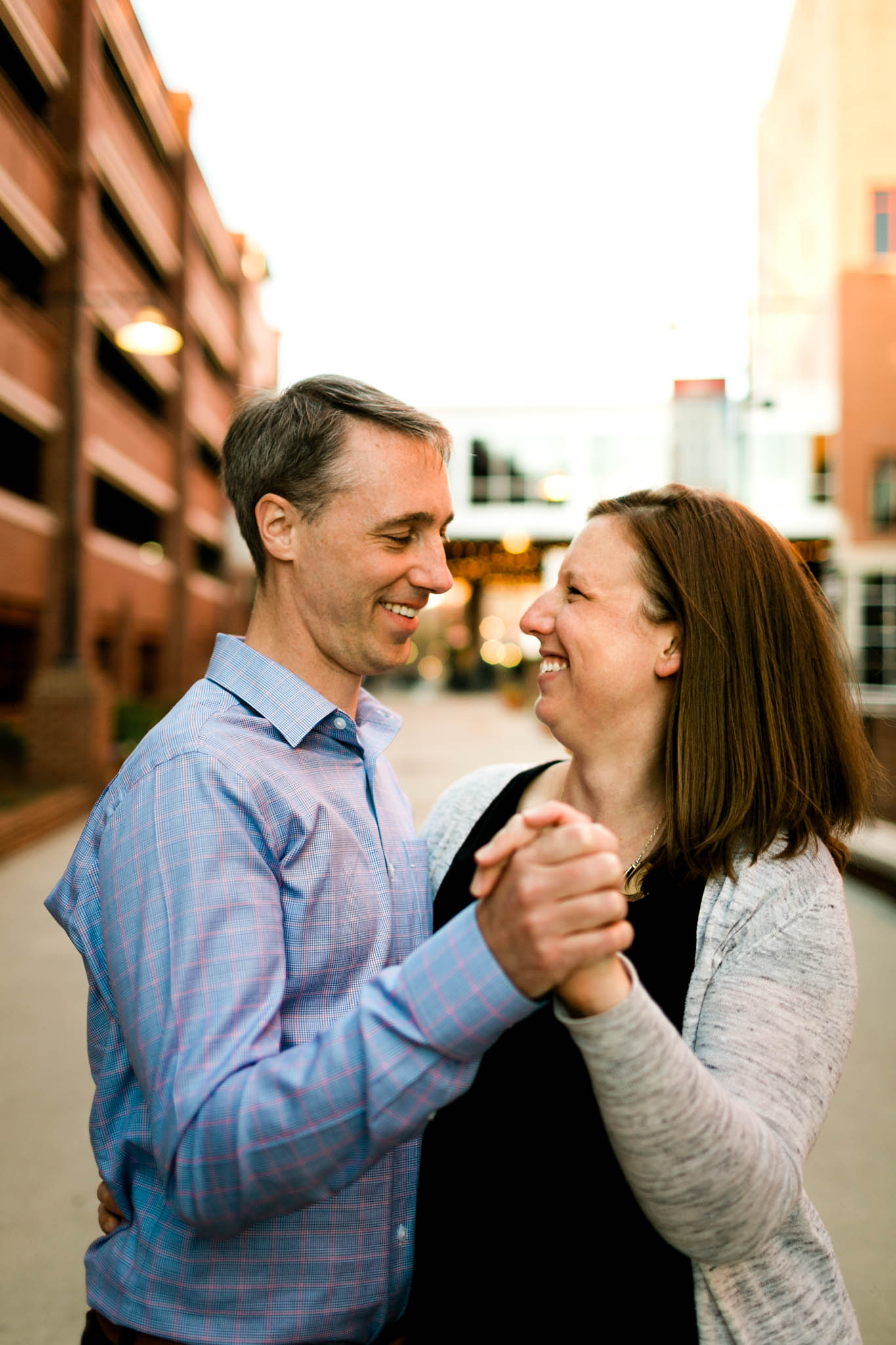 Couple smiling and dancing at American Tobacco Campus | Durham Family Photographer | By G. Lin Photography