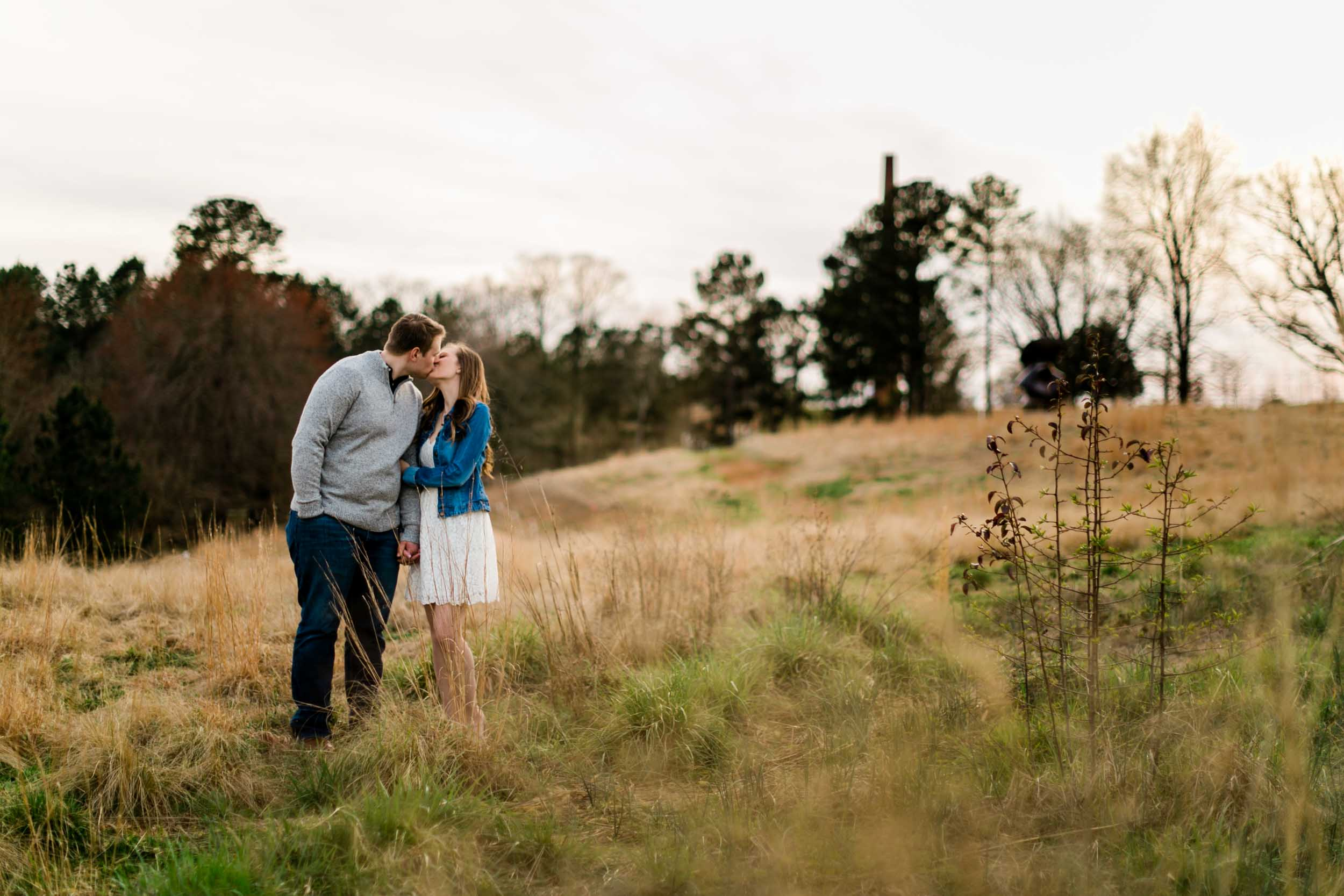 Couple kissing in open field | Durham Wedding Photographer | By G. Lin Photography
