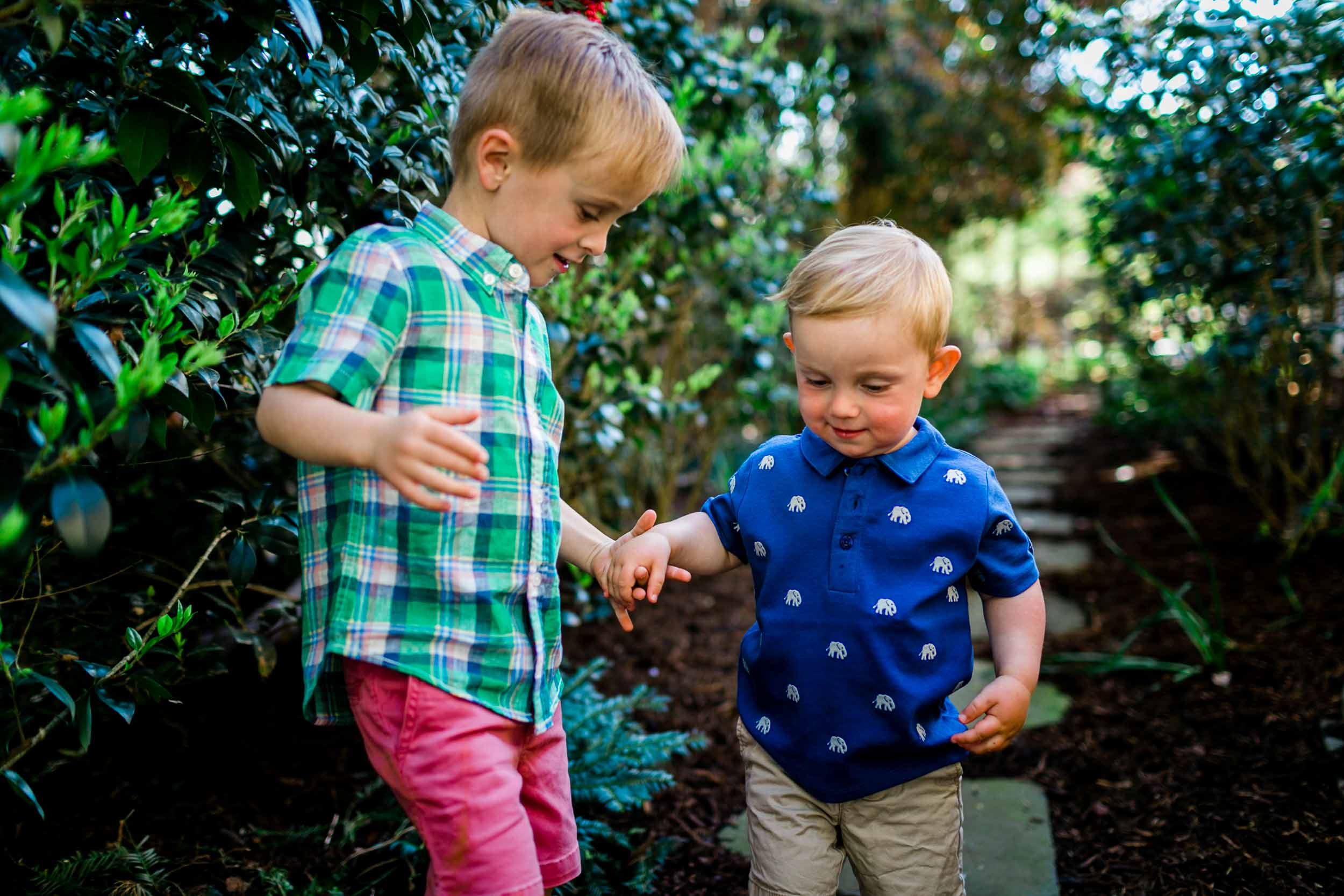 Brothers walking together outside | Raleigh Family Photographer | By G. Lin Photography