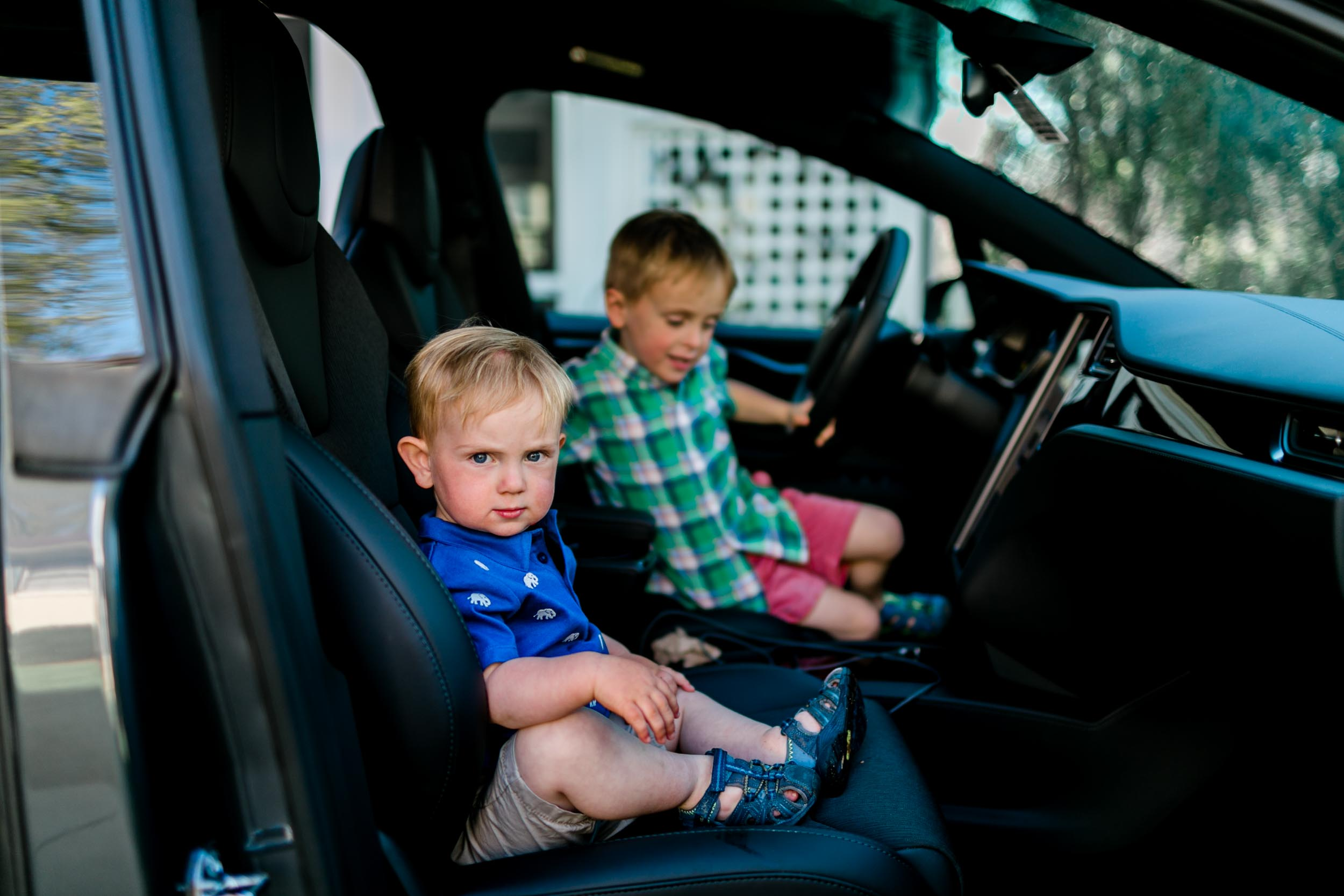 Brothers sitting inside of car | Durham Family Photographer | By G. Lin Photography