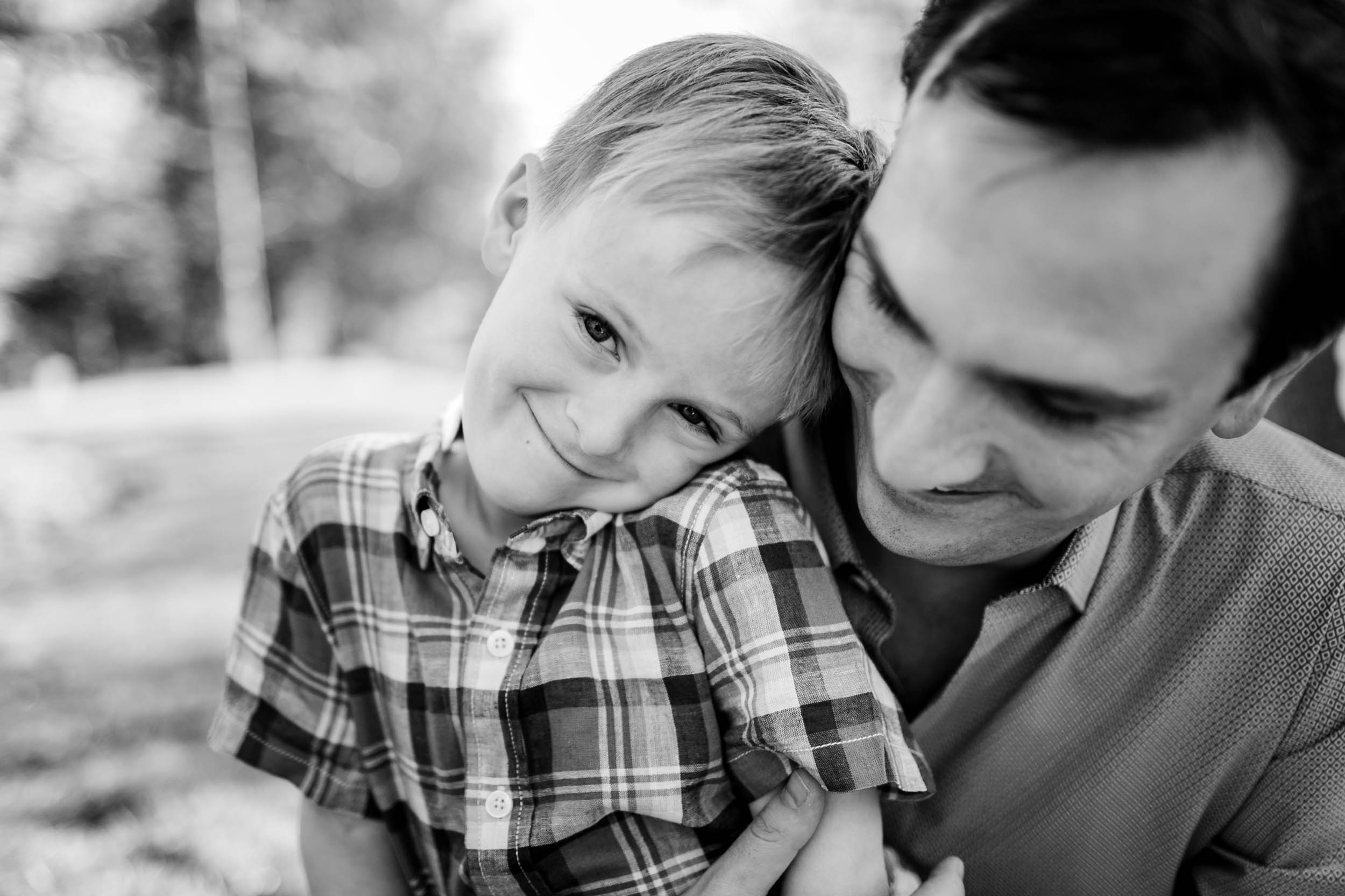 Black and white photo of father and son | Raleigh Family Photographer | By G. Lin Photography