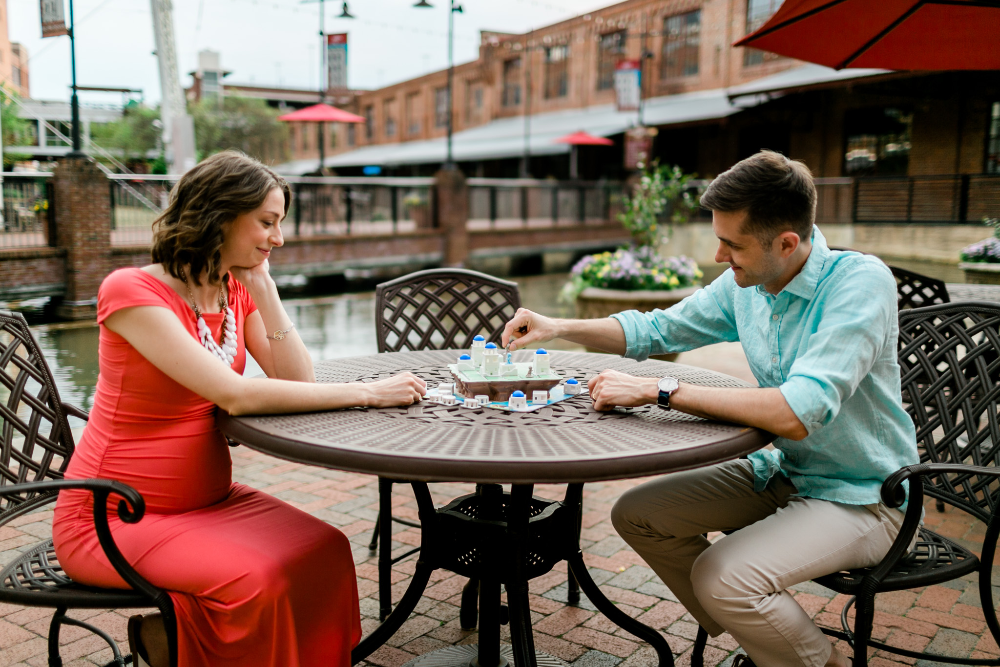 Couple playing board game outside | Durham Photographer | By G. Lin Photography