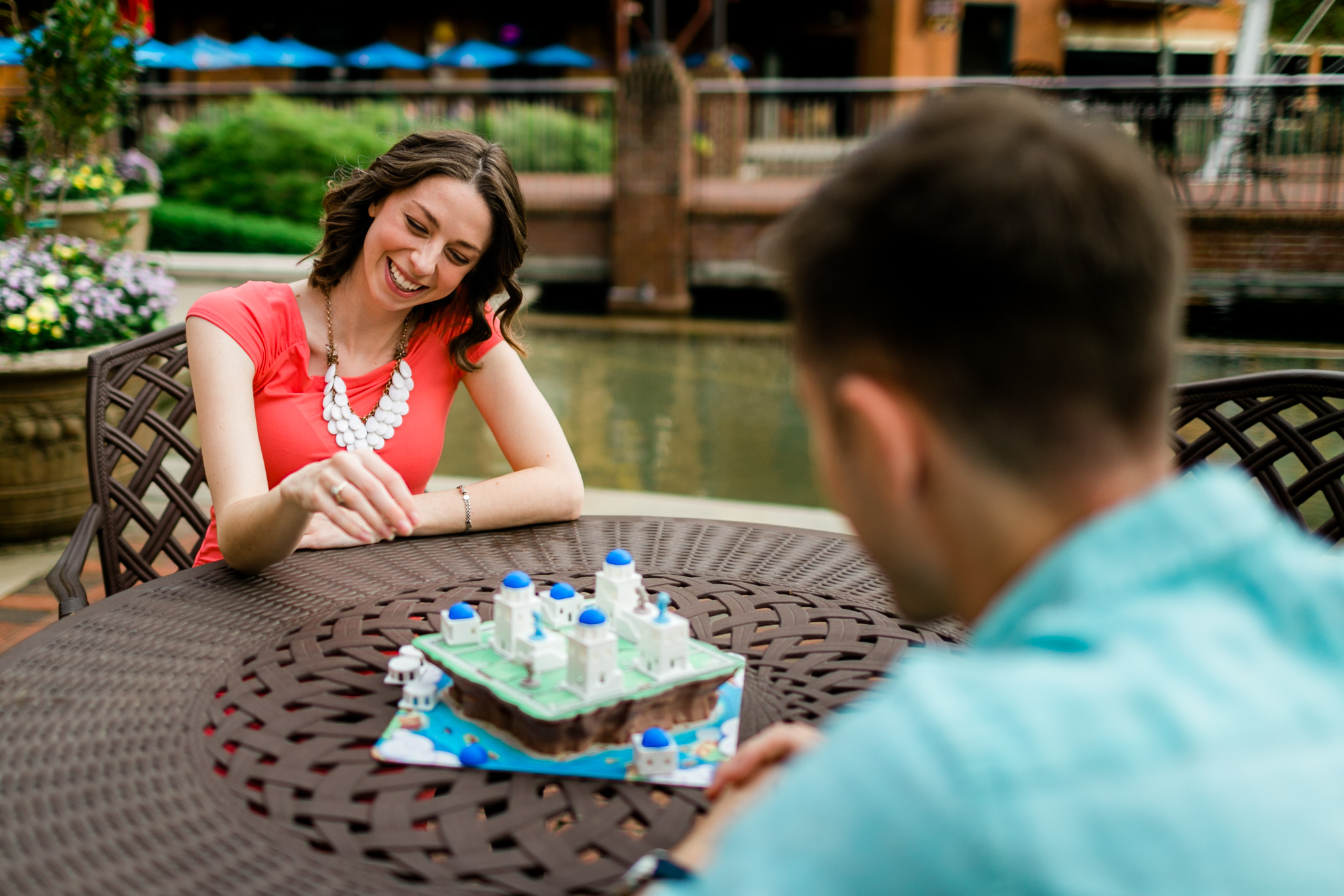 Couple playing board game outside | | Durham Photographer | By G. Lin Photography