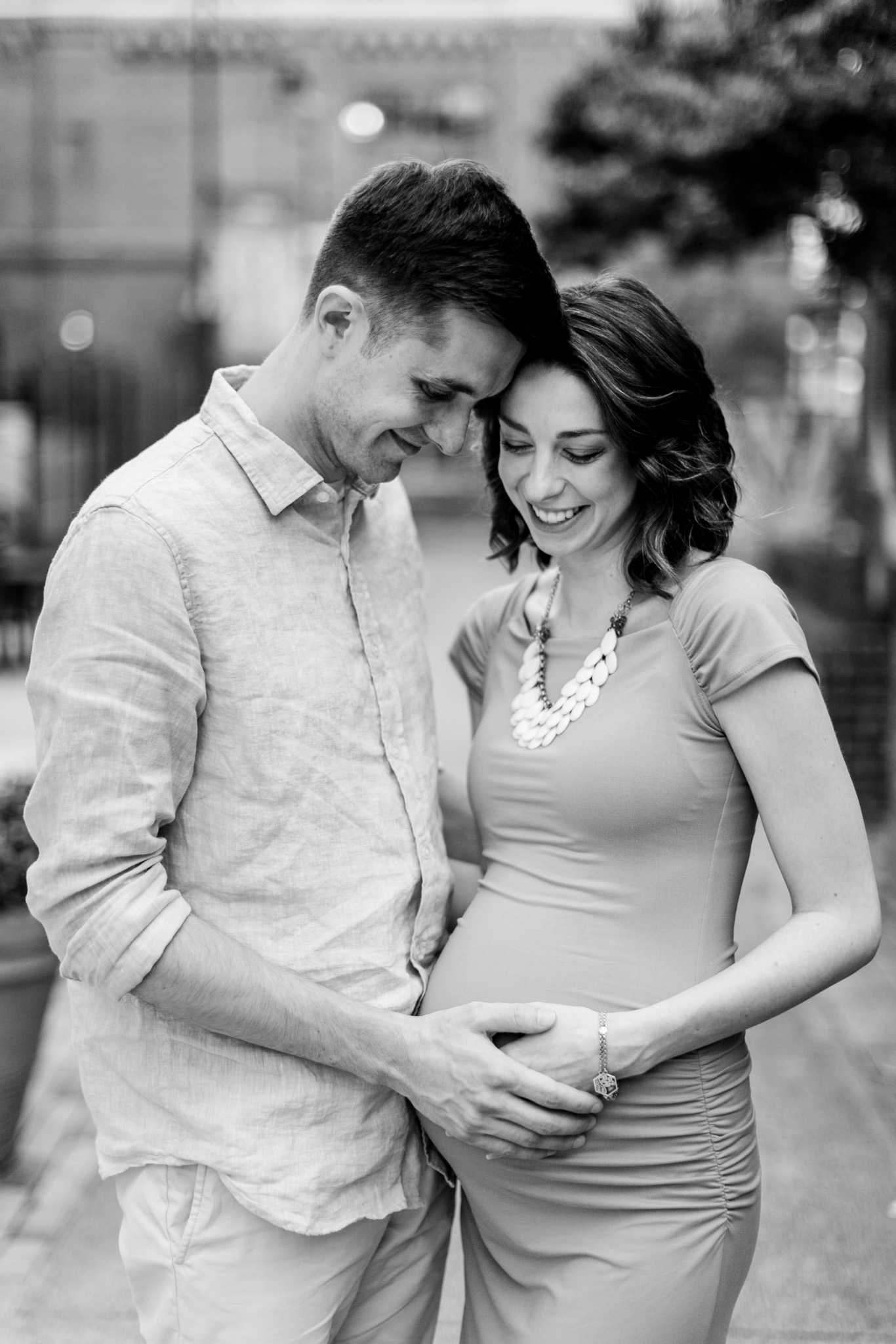 Beautiful black and white maternity photo of couple holding hands on belly | Durham Newborn Photographer | By G. Lin Photography
