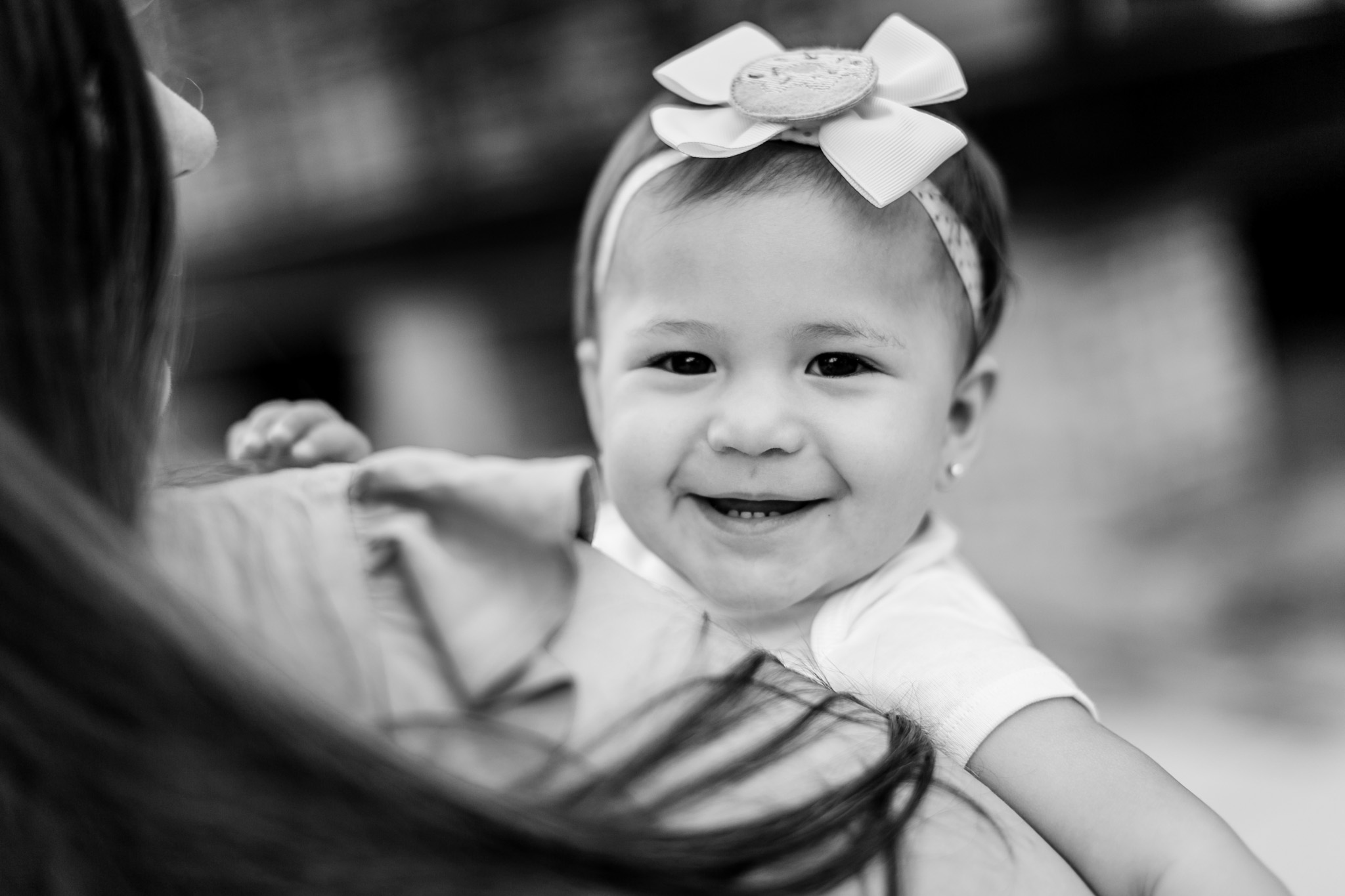 Black and white portrait of baby girl smiling | Durham Photographer | By G. Lin Photography