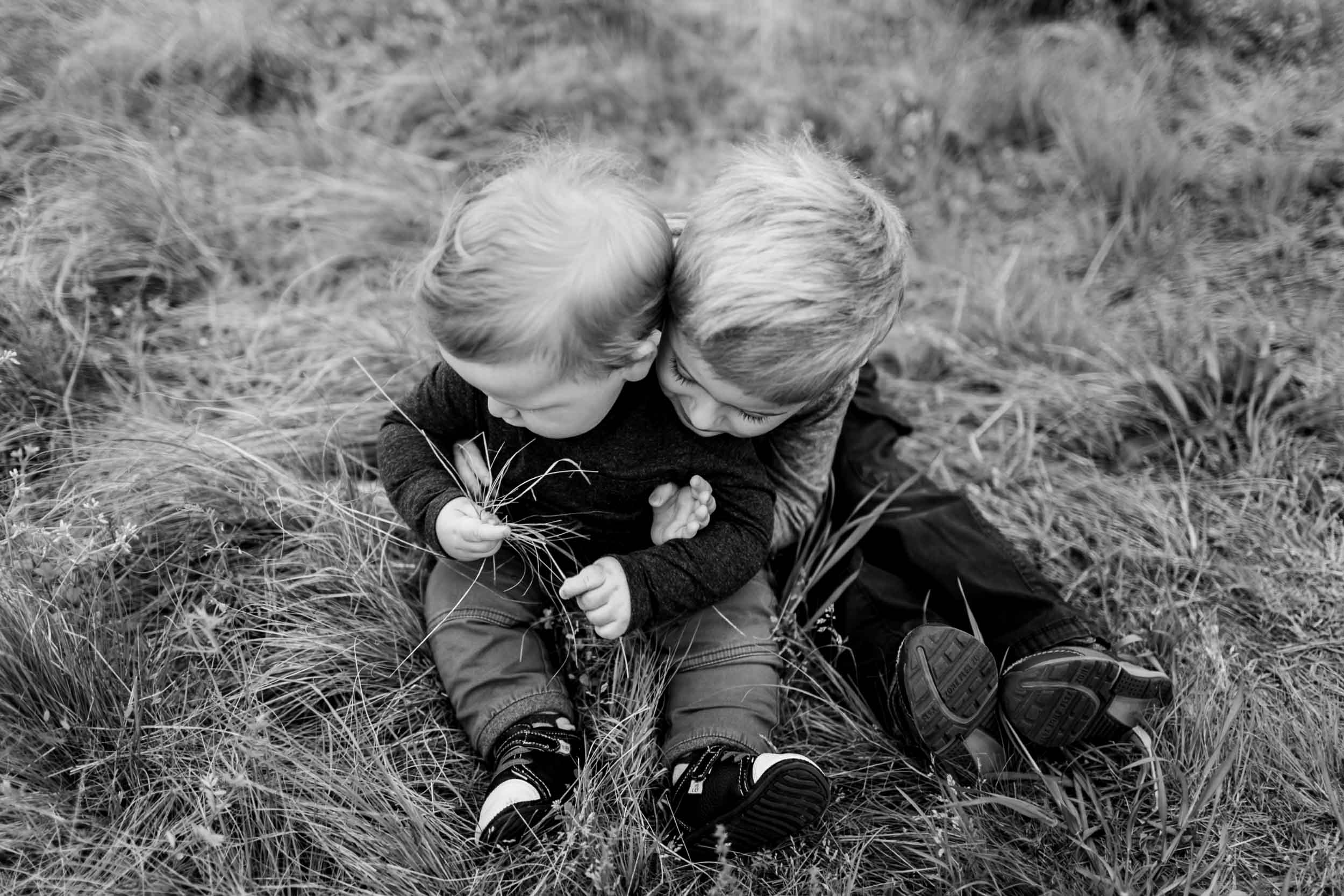 Black and white photo of brothers hugging | Raleigh Family Photographer | By G. Lin Photography